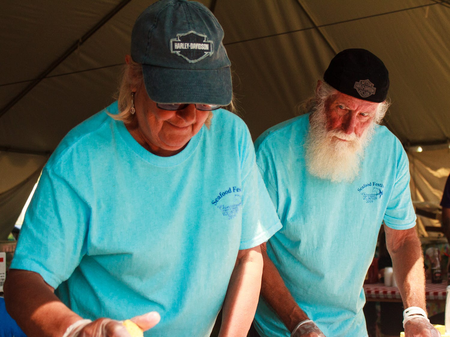 Jack and Jean Howard of Chincoteague, volunteer in handing out cornbread on Saturday, May 4, 2019 at the Chincoteague Seafood Festival in Chincoteague Island, Virginia.