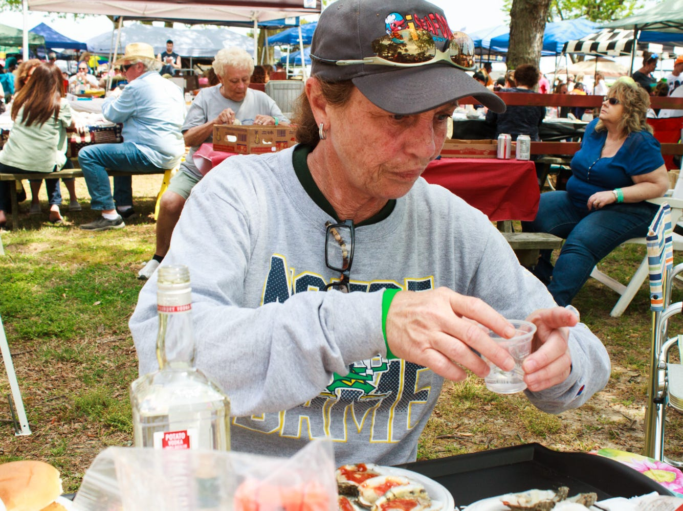 Lisa Van Fossen of Conshohocken, PA prepares oyster shots on Saturday, May 4, 2019 at the Chincoteague Seafood Festival in Chincoteague, VA.