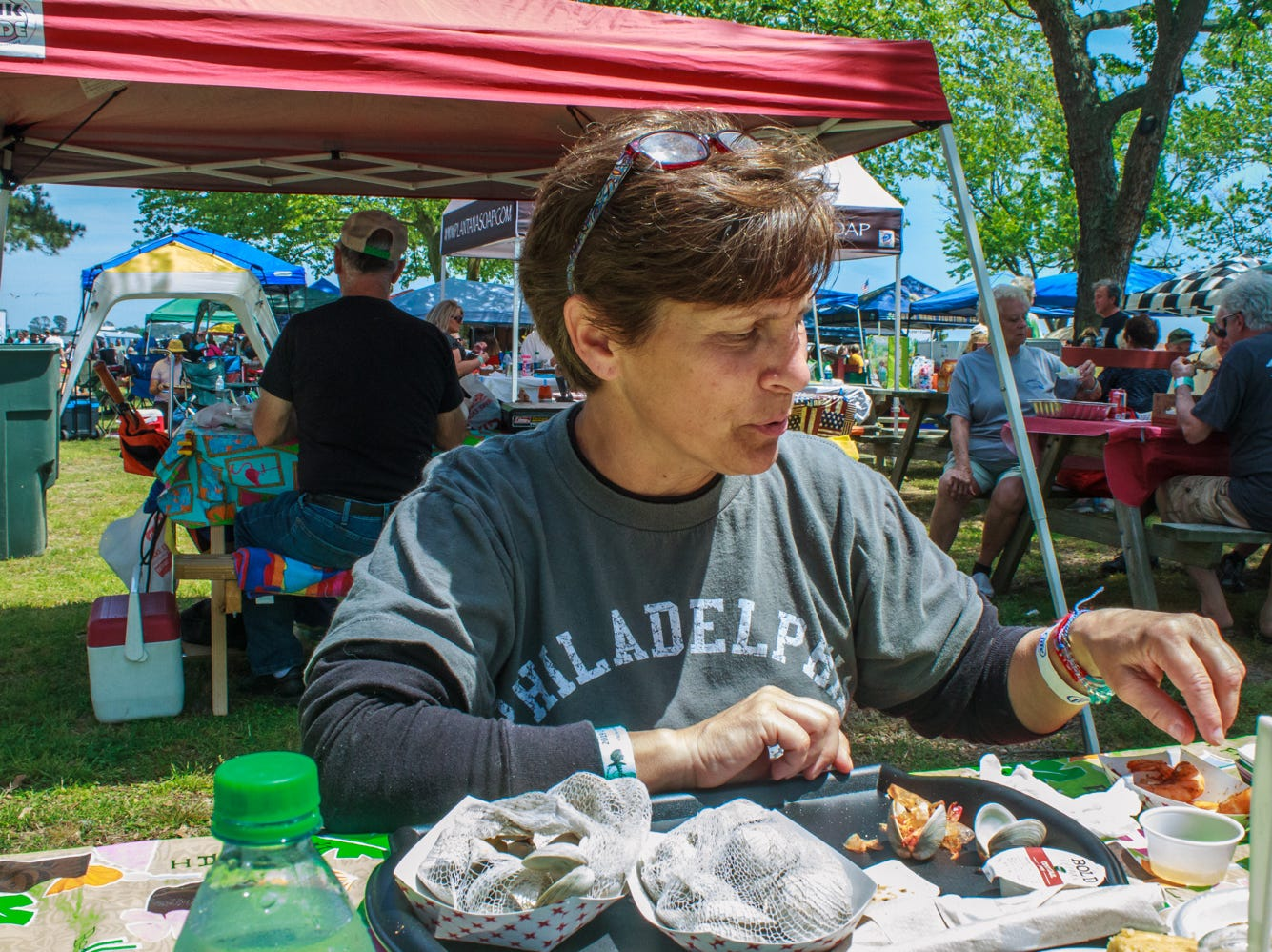 Carolyn Czarnecki of Conshohocken, Pa. gets ready to enjoy steamed shrimp on Saturday, May 4, 2019 at the Chincoteague Seafood Festival in Chincoteague, VA.