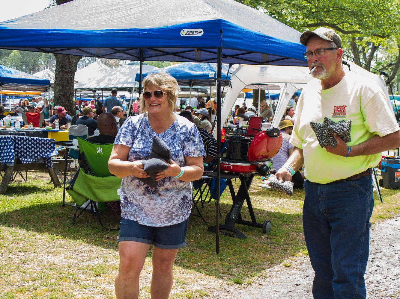 Joy Keller of Mercersburg, PA and Jim Pentz of Greencastle, PA get ready for their turn of cornhole on Saturday, May 4, 2019 at the Chincoteague Seafood Festival in Chincoteague, VA.