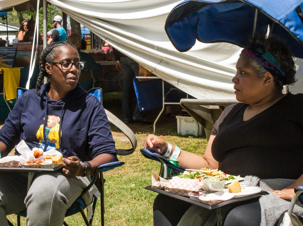 Crystal Moore and Gina Beale of Woodbury, N.J. get ready to begin eating on Saturday, May 4, 2019 at the Chincoteague Seafood Festival in Chincoteague, VA.