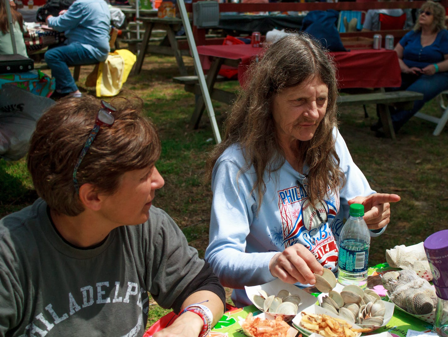 Sisters Carolyn and Helen Czarnecki of Conshohocken, Pa. discuss clams vs. oysters with friends on Saturday, May 4, 2019.