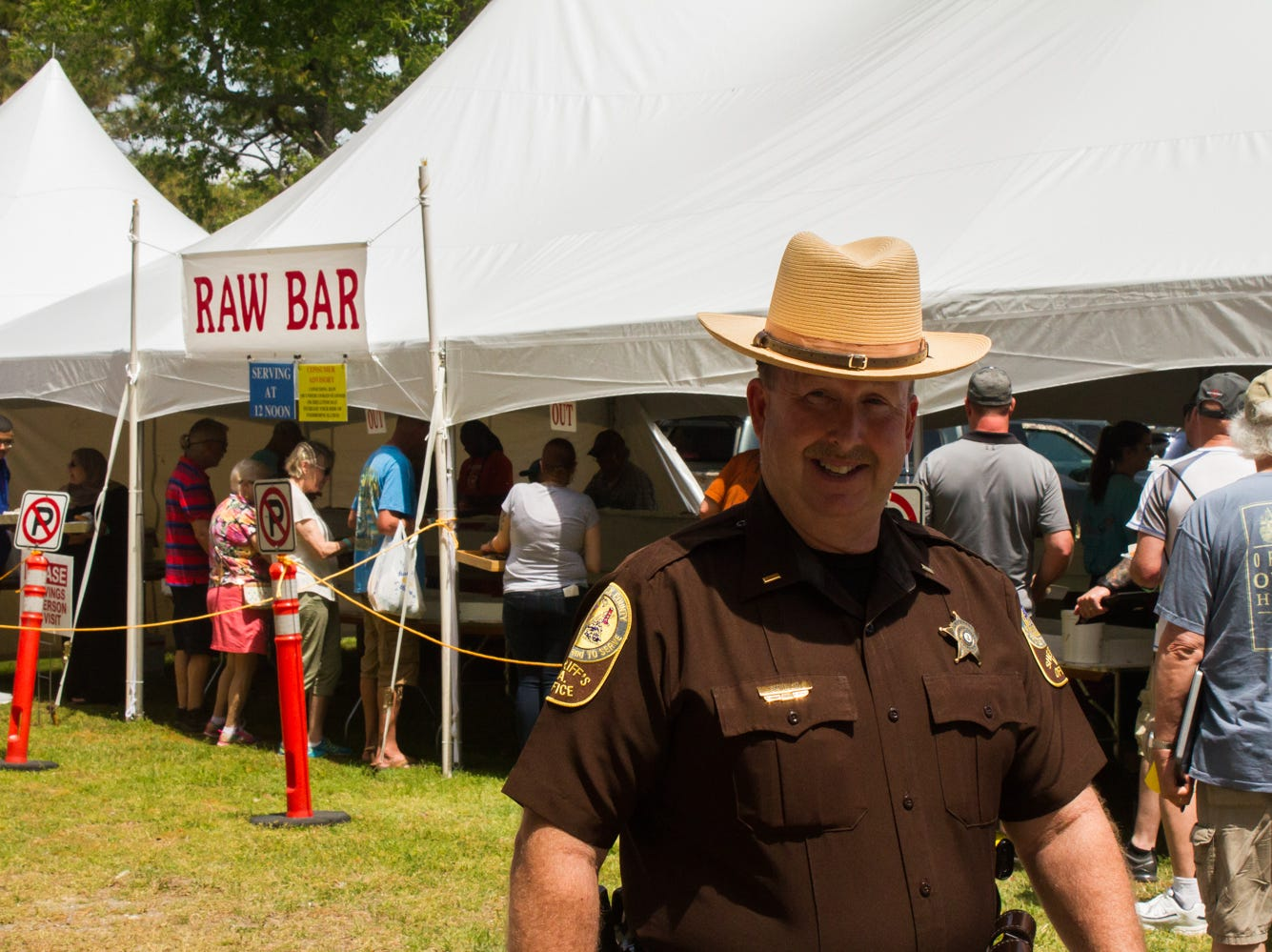 Lt. David Smullin of Accomack County Sheriff's Office helps maintain order within festival grounds on Saturday, May 4, 2019 at the Chincoteague Seafood Festival in Chincoteague, VA.