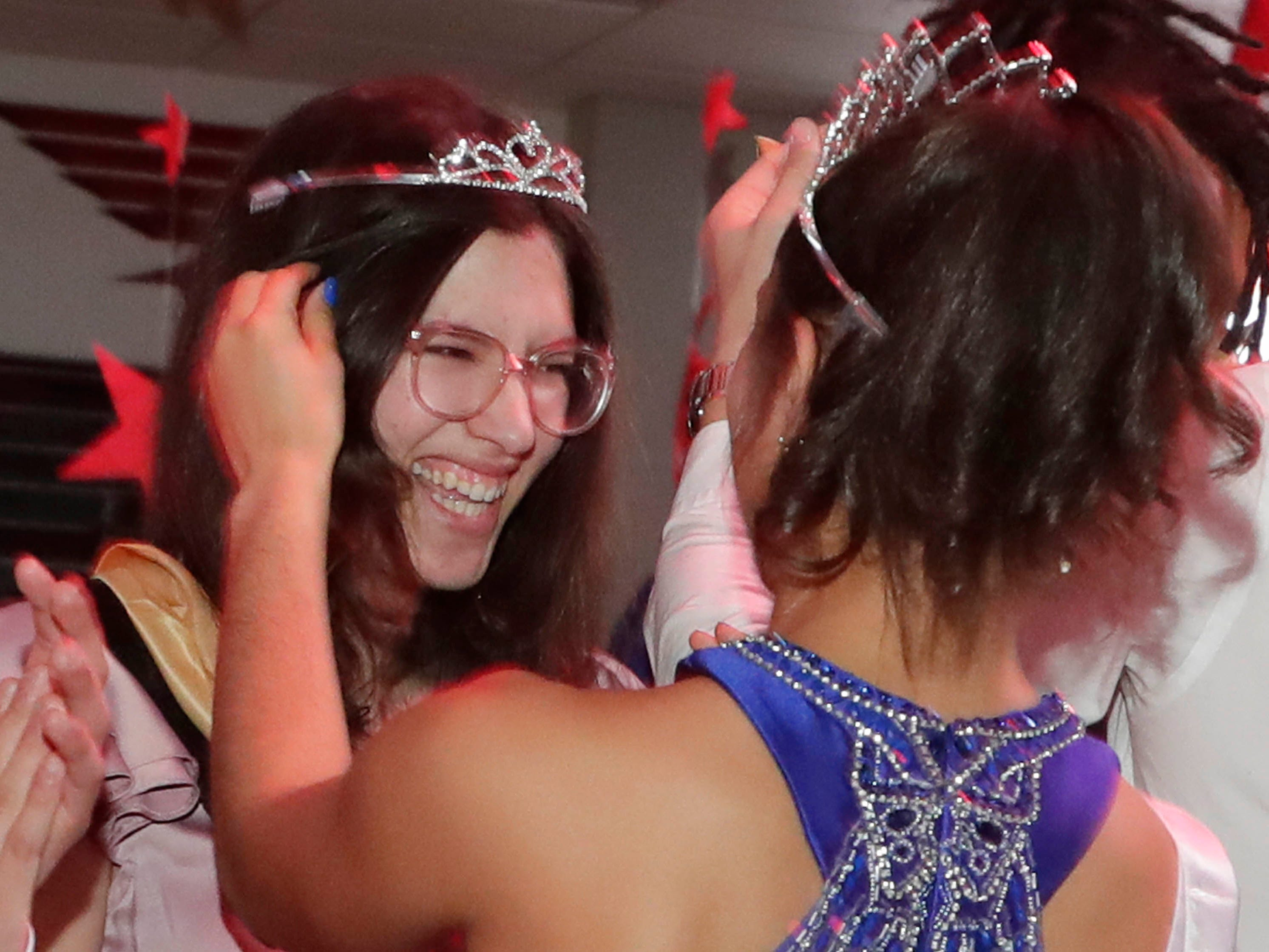 Queen Camila Trimberger smiles as she is crowned at the Sheboygan South Prom, Saturday, Mary 4, 2019, in Sheboygan, Wis.
