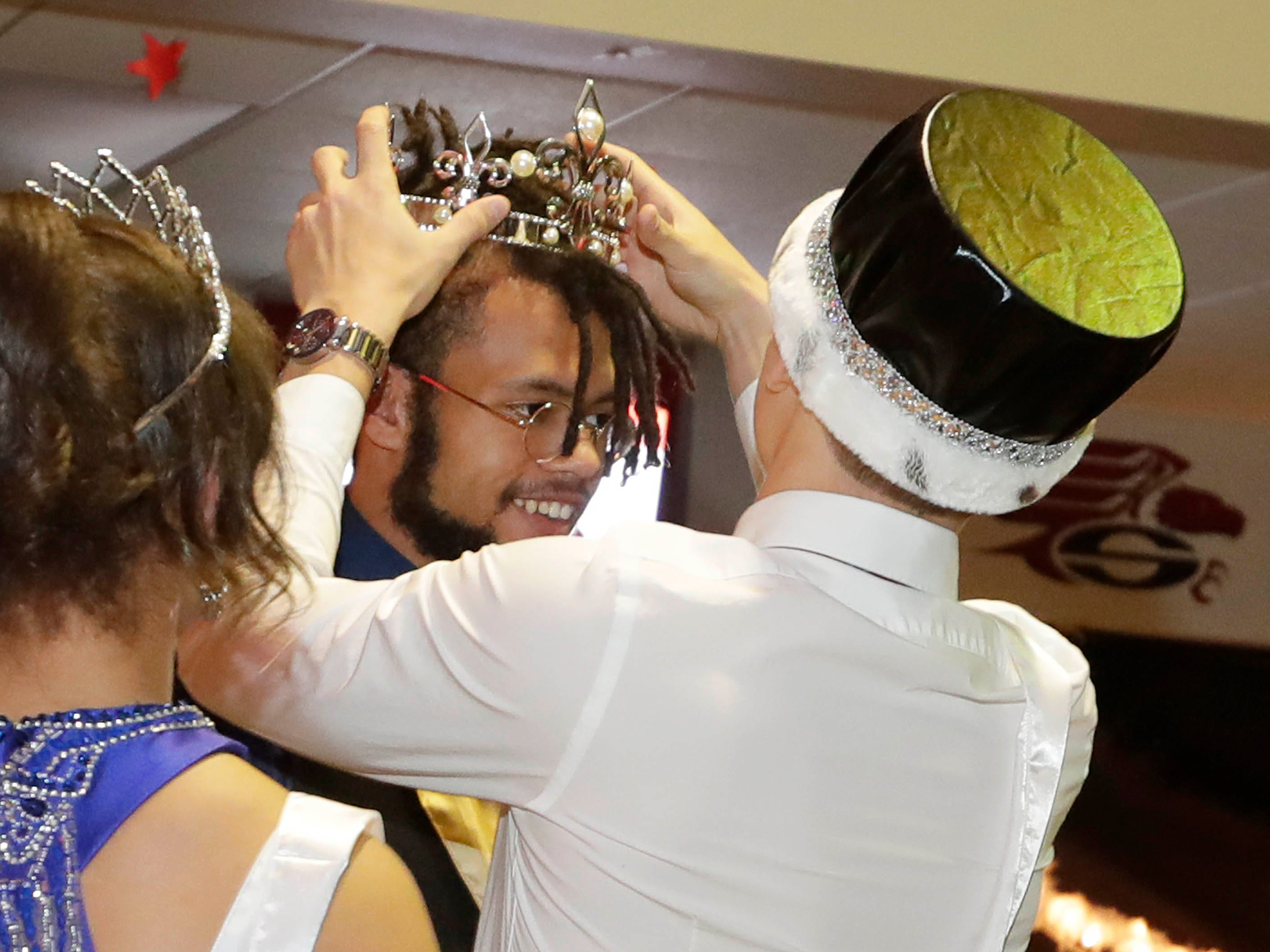 King Jacksen Wolff smiles as he is crowned at the Sheboygan South Prom, Saturday, Mary 4, 2019, in Sheboygan, Wis.