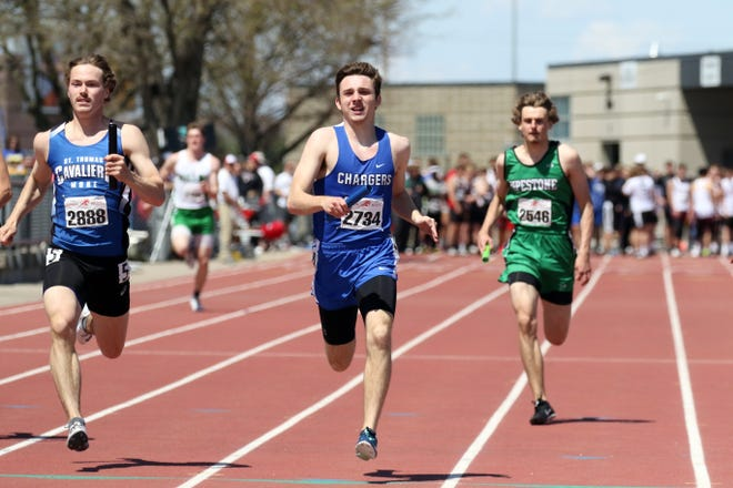 Parker Nelson of Sioux Falls Christian battles Jacob Hyde of St Thomas More in the 4 x 200 at the Howard Wood Relays on Saturday in Sioux Falls.