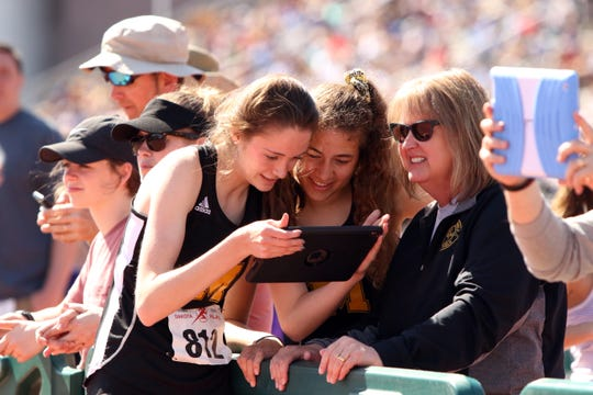 Carly Haring of Mitchell watches a replay of her last jump at the Howard Wood Relays on Saturday in Sioux Falls.