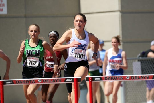 Elizabeth Schaefer of Rapid City Stevens runs the 300 Hurdles at the Howard Wood Relays on Saturday in Sioux Falls.