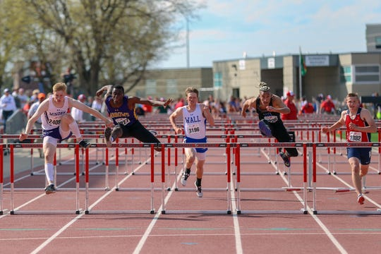 Running of the high school boys 110 meter hurdles at the 94th annual Howard Wood Dakota Relays in Sioux Falls, SD. Watertown's Pierre Lear (second from left) placed second.