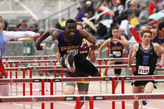 Pierre Lear of Watertown runs his opening heat of the 110 Hurdles on Friday at Howard Wood Relays in Sioux Falls.