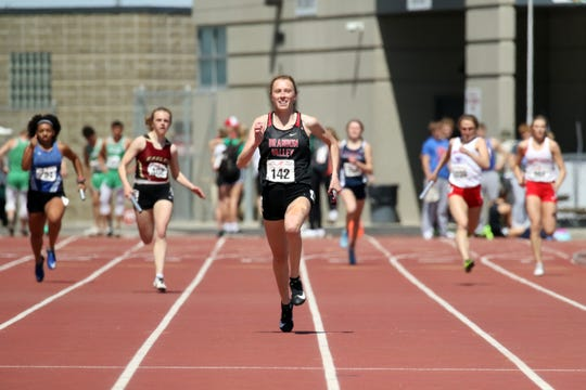 Brandon Valley's Krista Bickley smiles as she heads to the finish in the 4 x 200 relay at the Howard Wood Relays on Saturday in Sioux Falls.