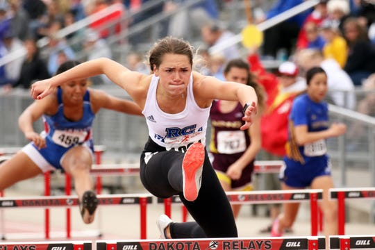 Elizabeth Schaefer of Rapid City Stevens clears a hurdle during her prelim race at Howard Wood on Friday in Sioux Falls.