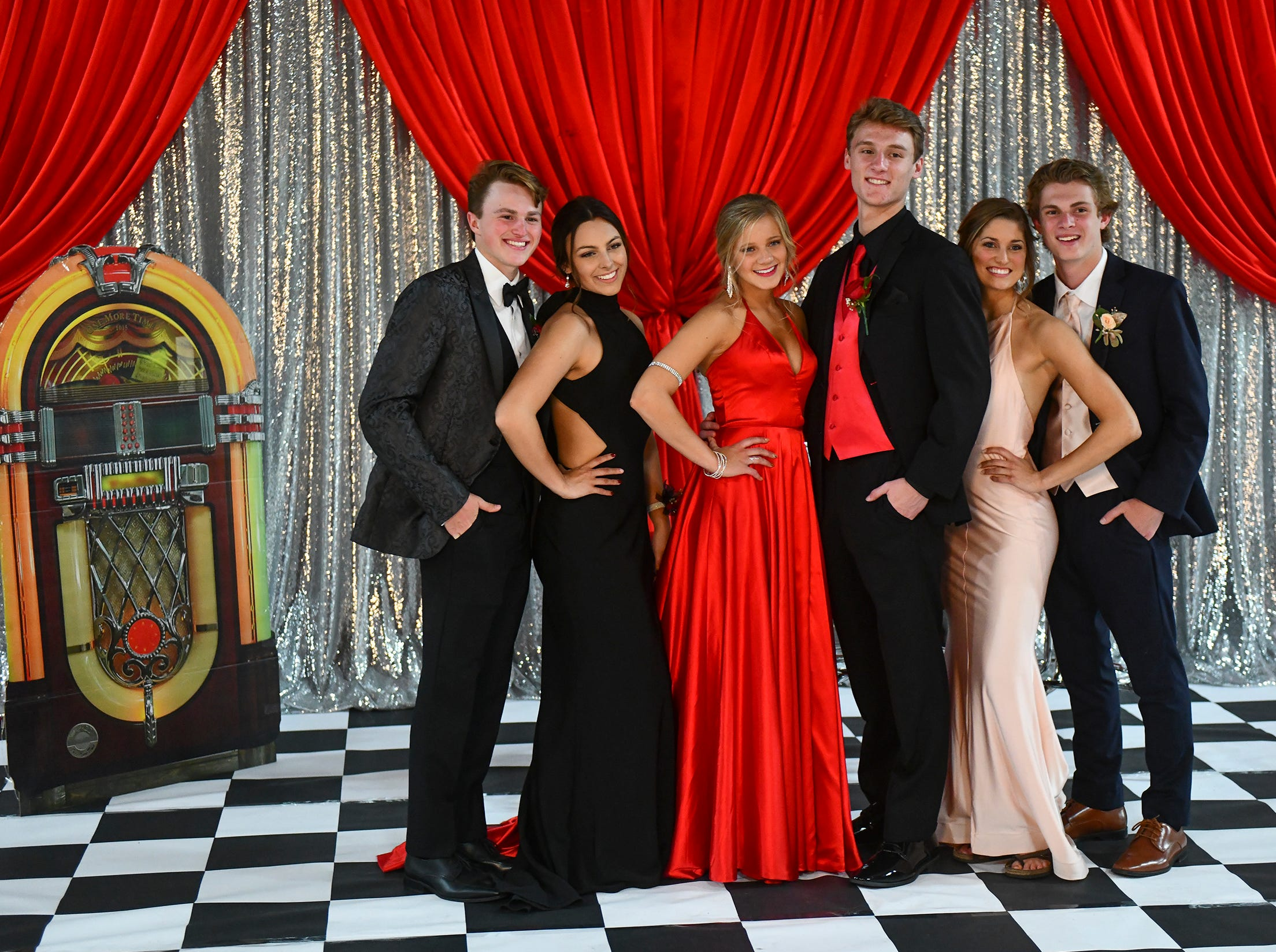 Promgoers strike a pose during Sartell High School prom Saturday, May 4, in St. Cloud.