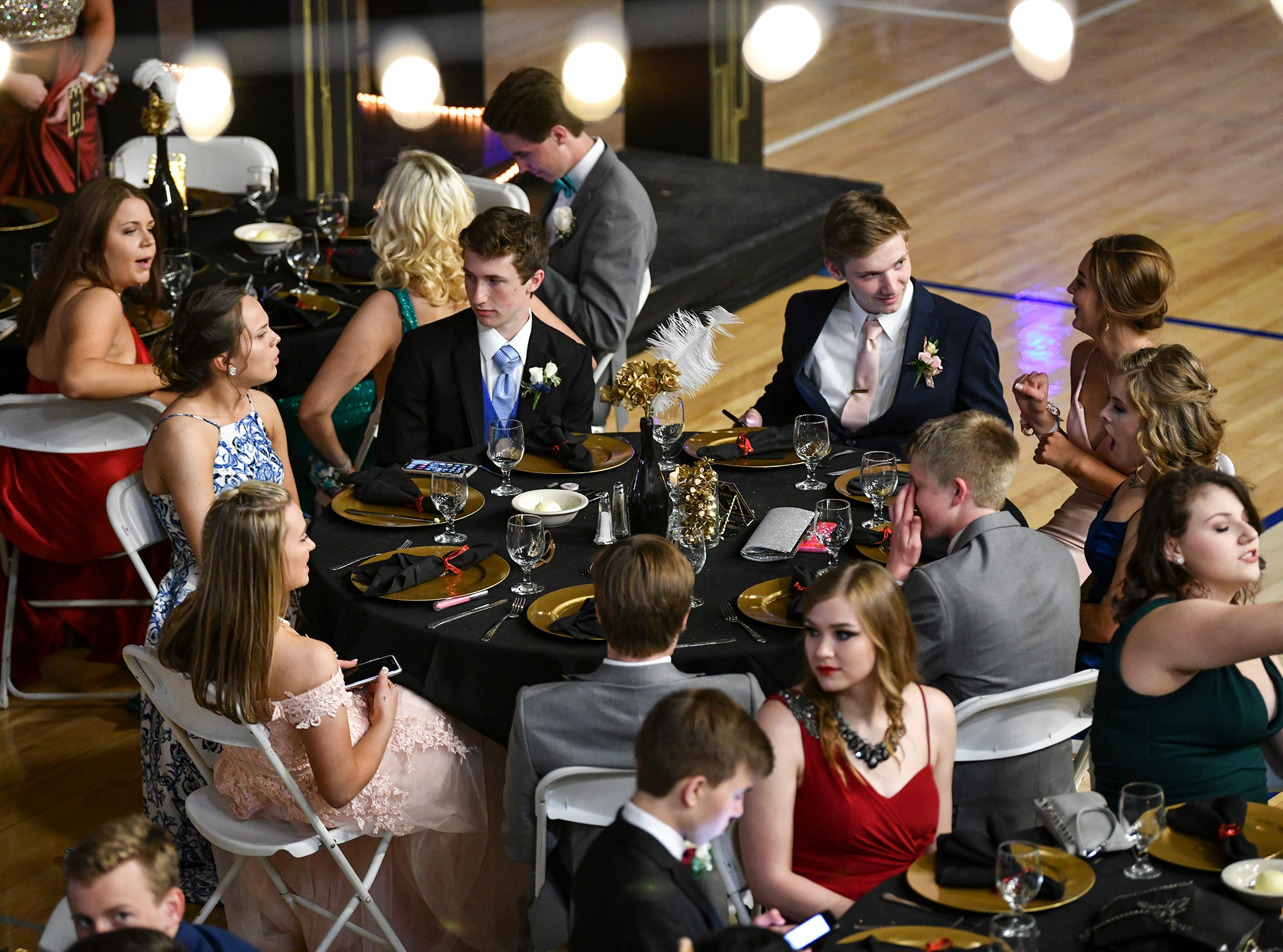 Couples take their seats for prom Saturday, May 4, at Cathedral High School in St. Cloud.