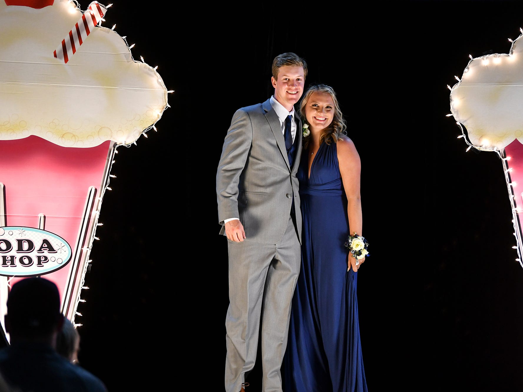 Couples take their turn on the grand march route during Sartell High School's prom Saturday, May 4, at the River's Edge Convention Center in St. Cloud.