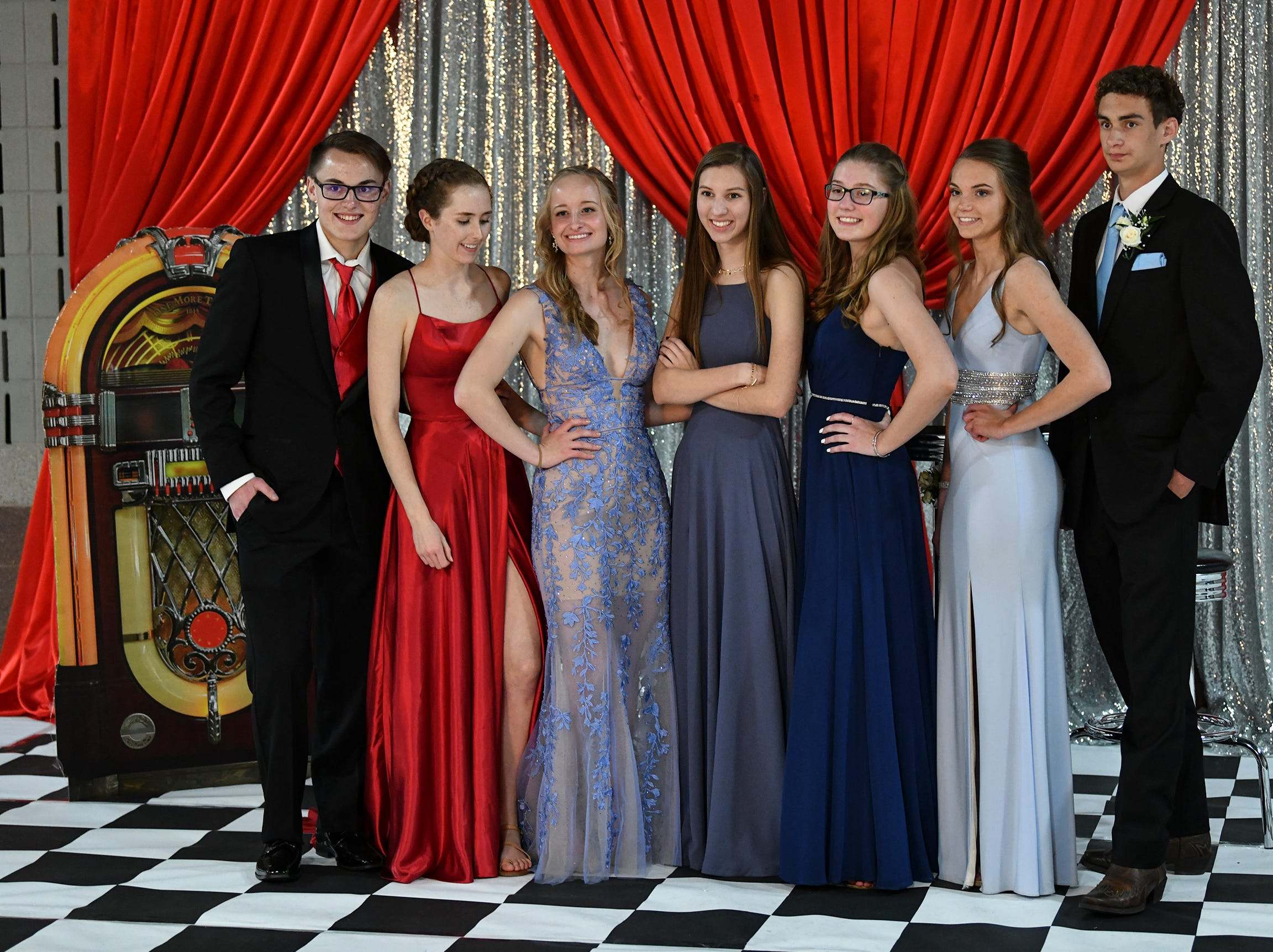 Friends gather for a photo during Sartell High School's prom Saturday, May 4, at the River's Edge Convention Center in St. Cloud.