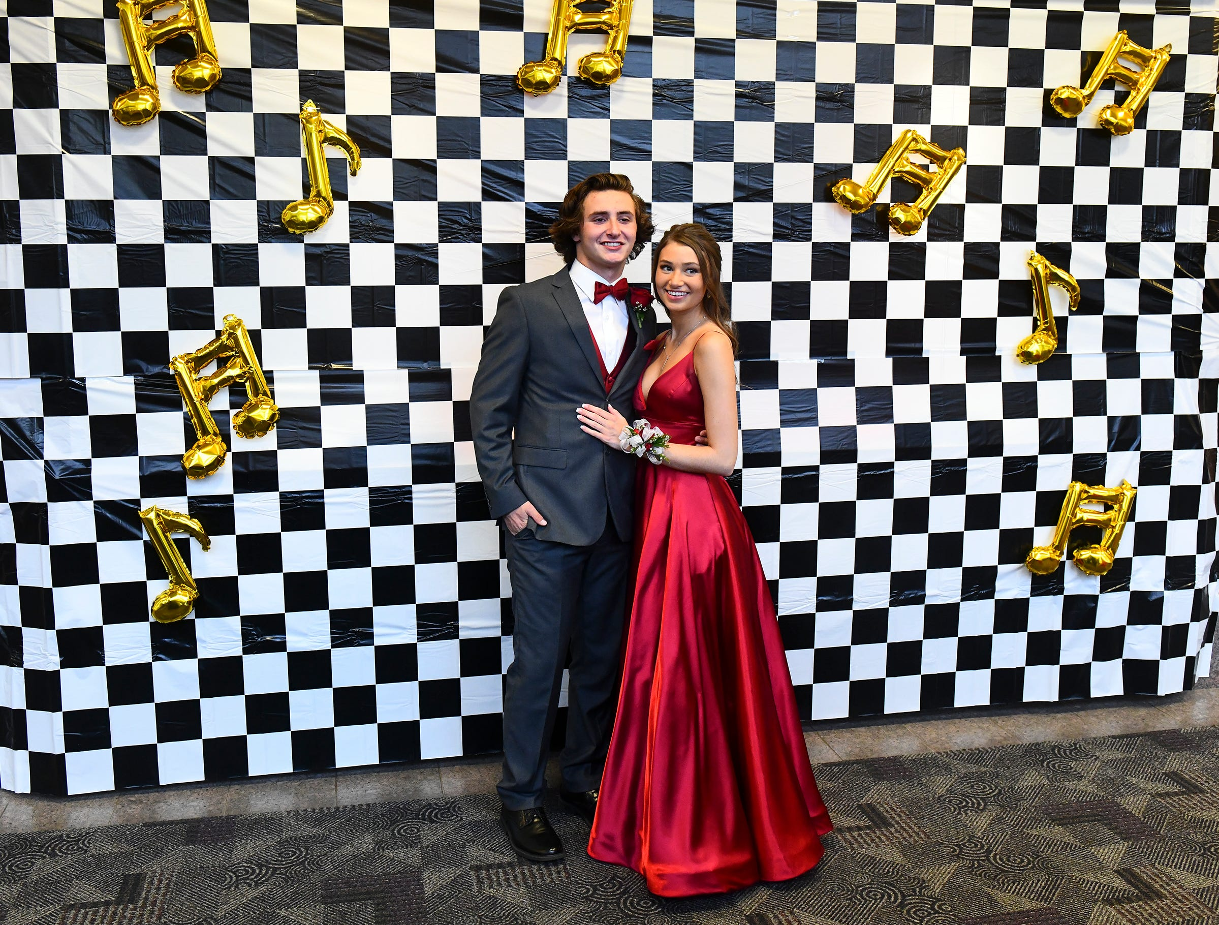 Kalley Vande Vrede and Chris Vance pose in front of a backdrop during Sartell High School prom Saturday, May 4, in St. Cloud.
