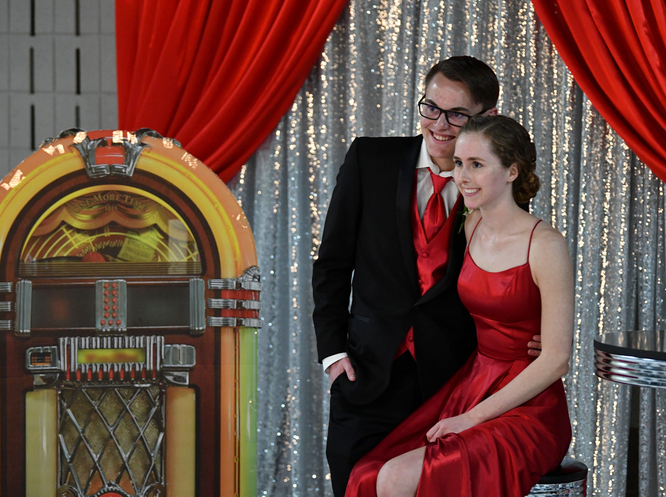 Students pose for a photo during Sartell High School prom Saturday, May 4, in St. Cloud.
