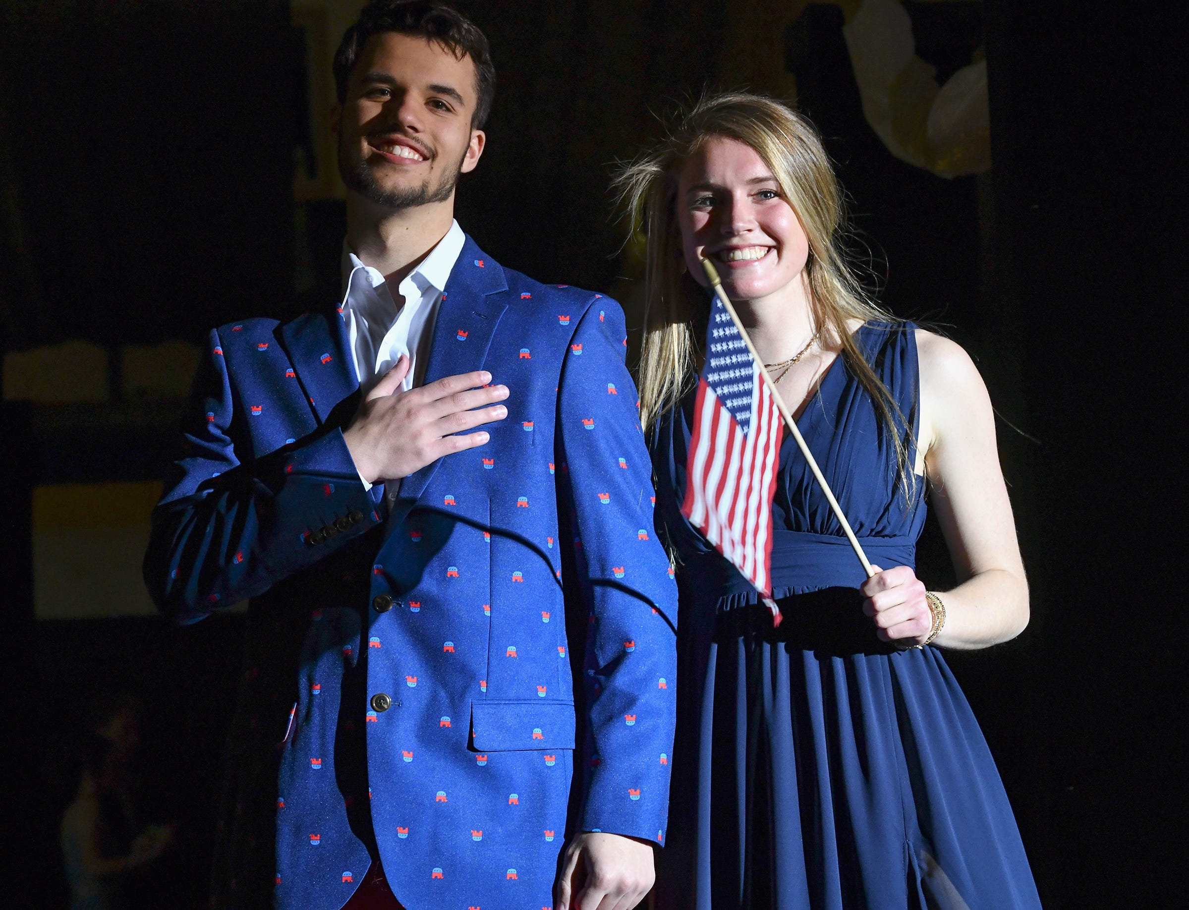 Students strike a patriotic pose during prom grand march Saturday, May 4, at Cathedral High School in St. Cloud.