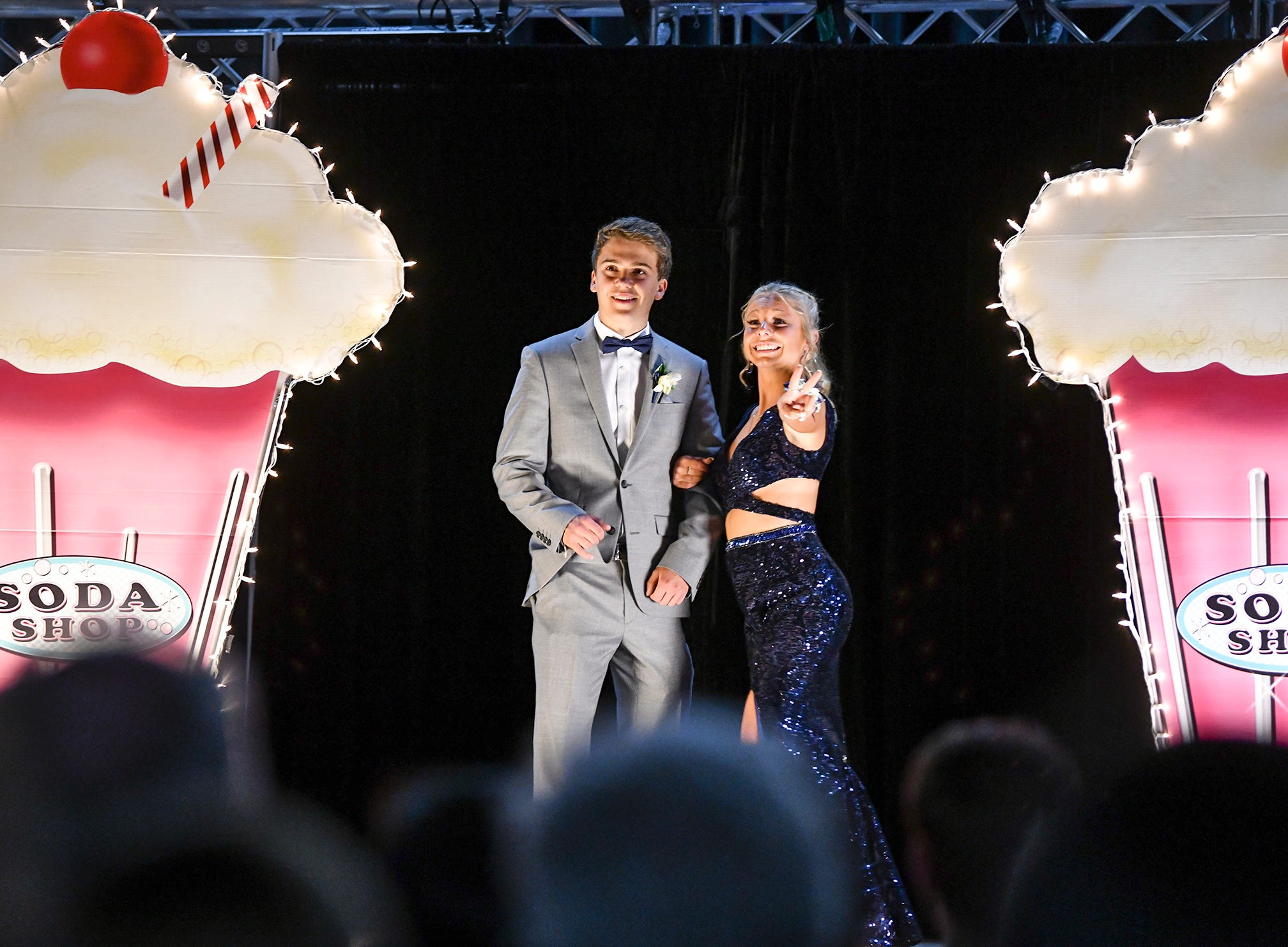A couple poses on the grand march route during Sartell High School's prom Saturday, May 4, at the River's Edge Convention Center in St. Cloud.