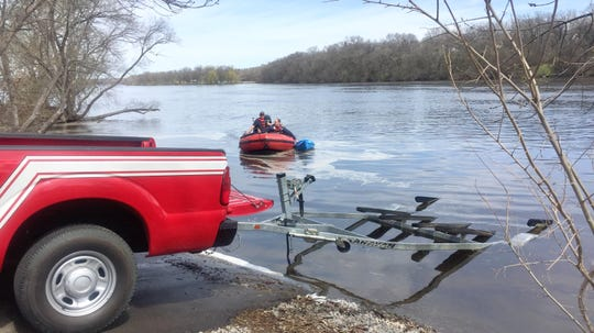 St. Cloud firefighters retrieve a kayak from the Mississippi River at about 12:05 p.m. Sunday, May 5 after reports two people overturned their kayaks near the Sauk Rapids bridge.