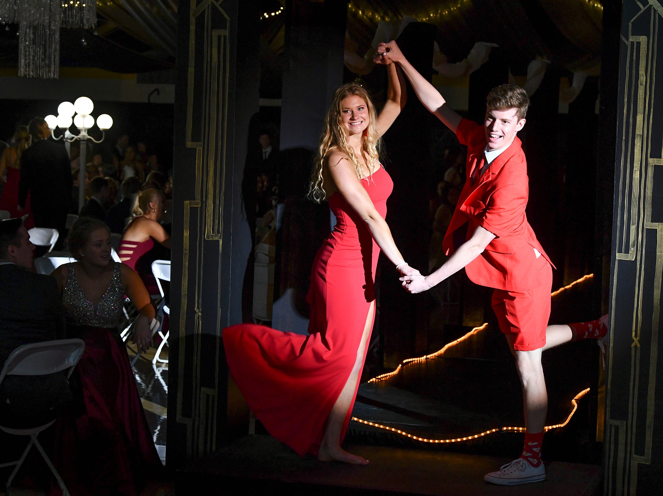 Students strike a pose during prom grand march Saturday, May 4, at Cathedral High School in St. Cloud.