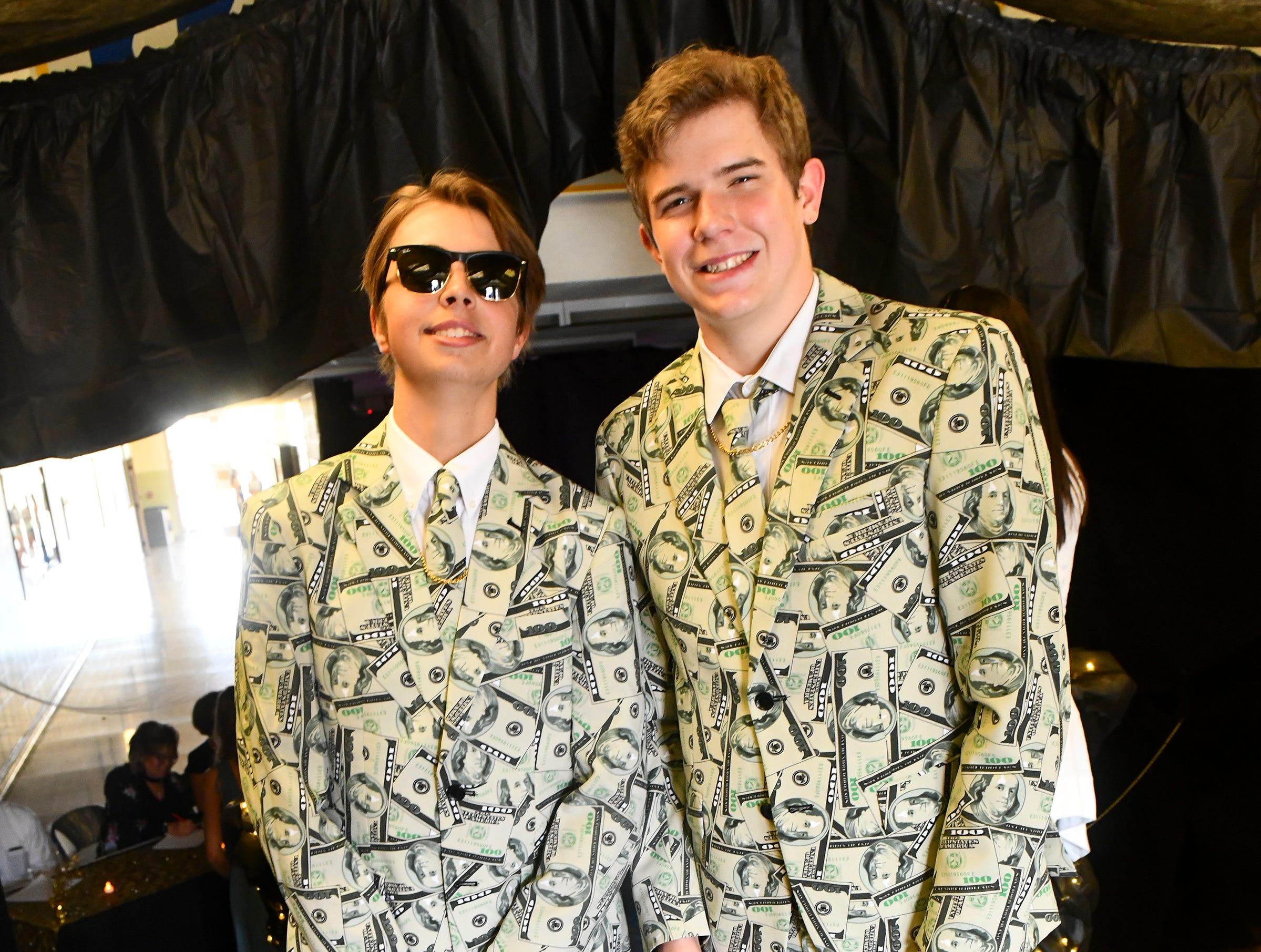 Luke Ellis and Nathan Budde wear matching money suits for prom Saturday, May 4, at Cathedral High School in St. Cloud.