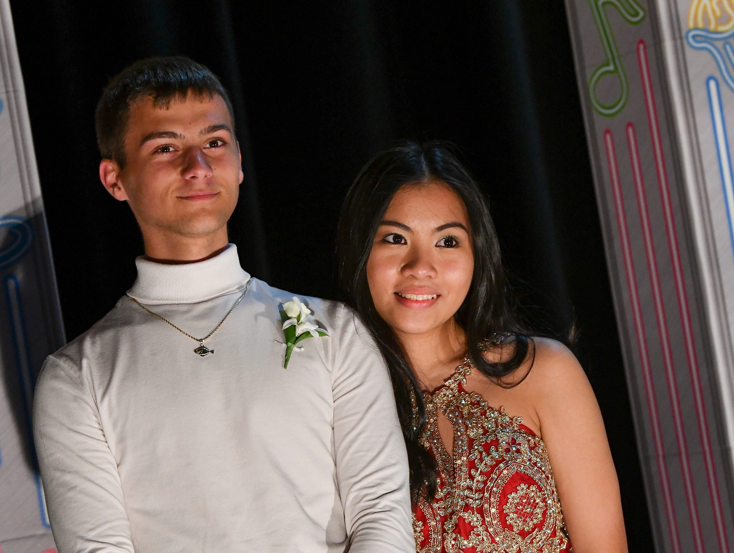 A couple smiles during prom Saturday.