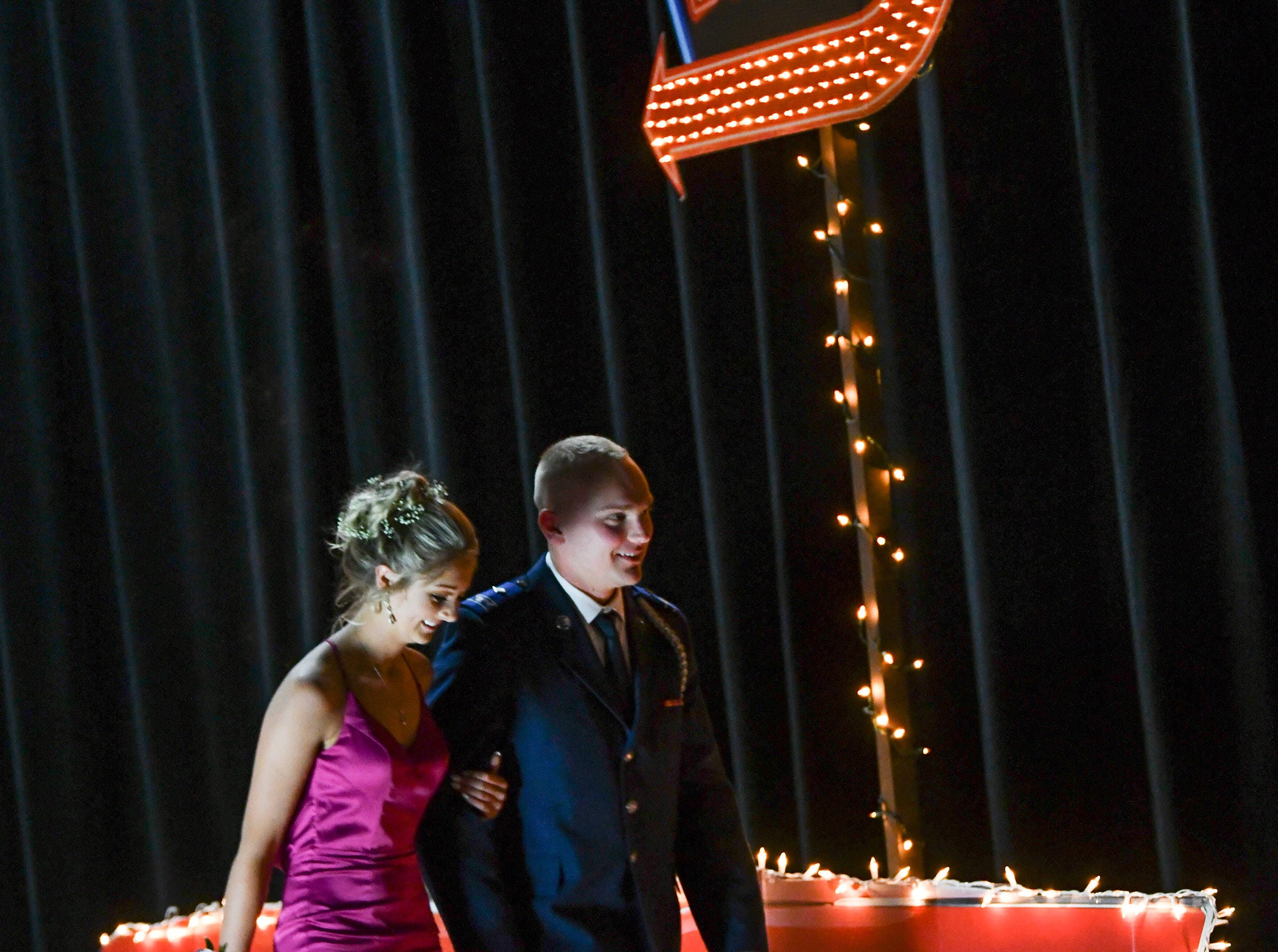 Couples leave the stage during Sartell High School prom grand march Saturday, May 4, in St. Cloud.