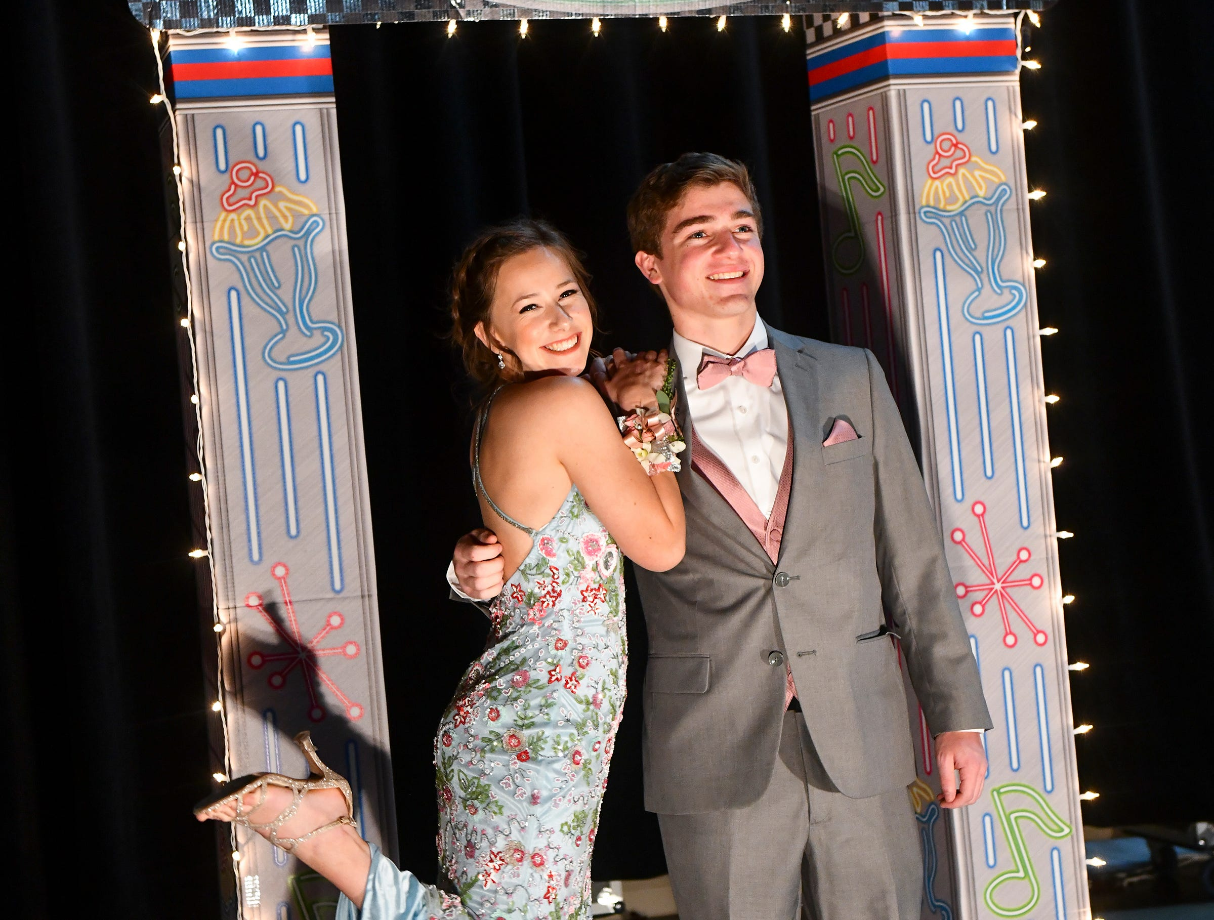 Promgoers strike a pose during Sartell High School's prom grand march Saturday, May 4, at the River's Edge Convention Center in St. Cloud.