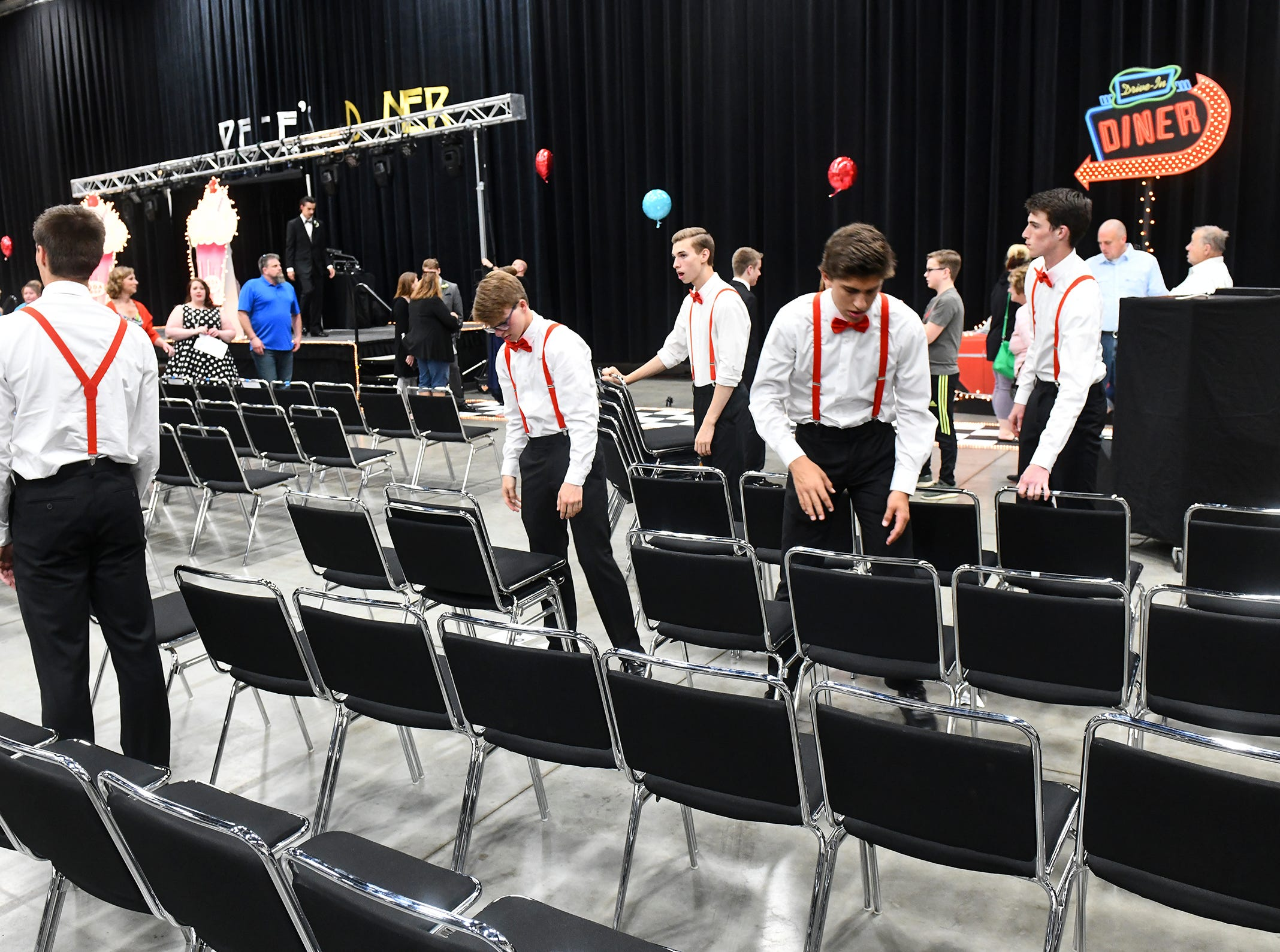Chairs are removed following grand march during Sartell High School prom Saturday, May 4, in St. Cloud.