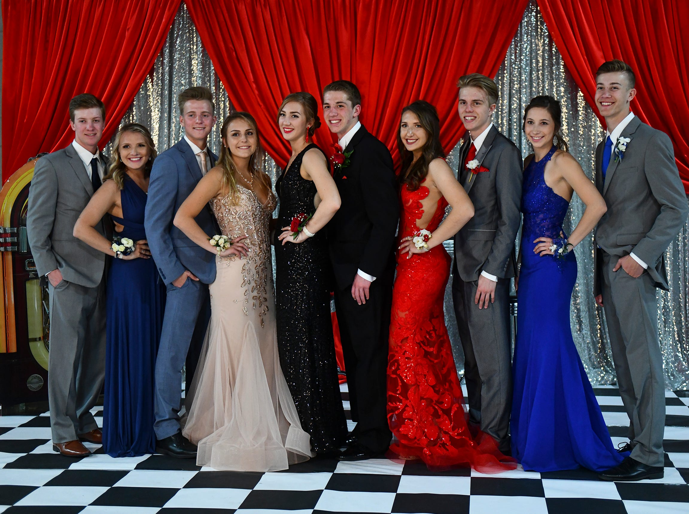 Friends gather for a photograph during Sartell High School prom Saturday, May 4, in St. Cloud.