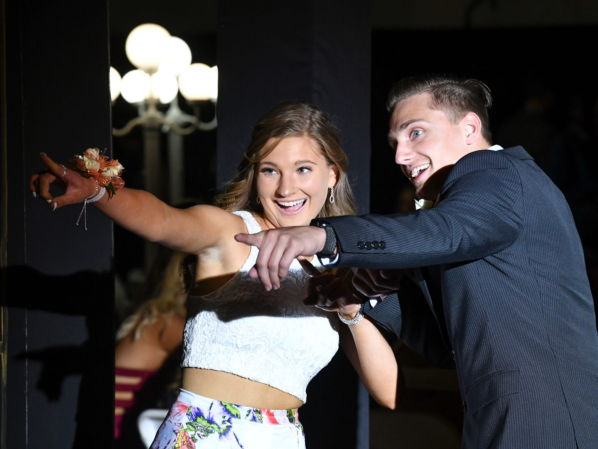 Promgoers strike a pose during prom grand march Saturday, May 4, at Cathedral High School in St. Cloud.