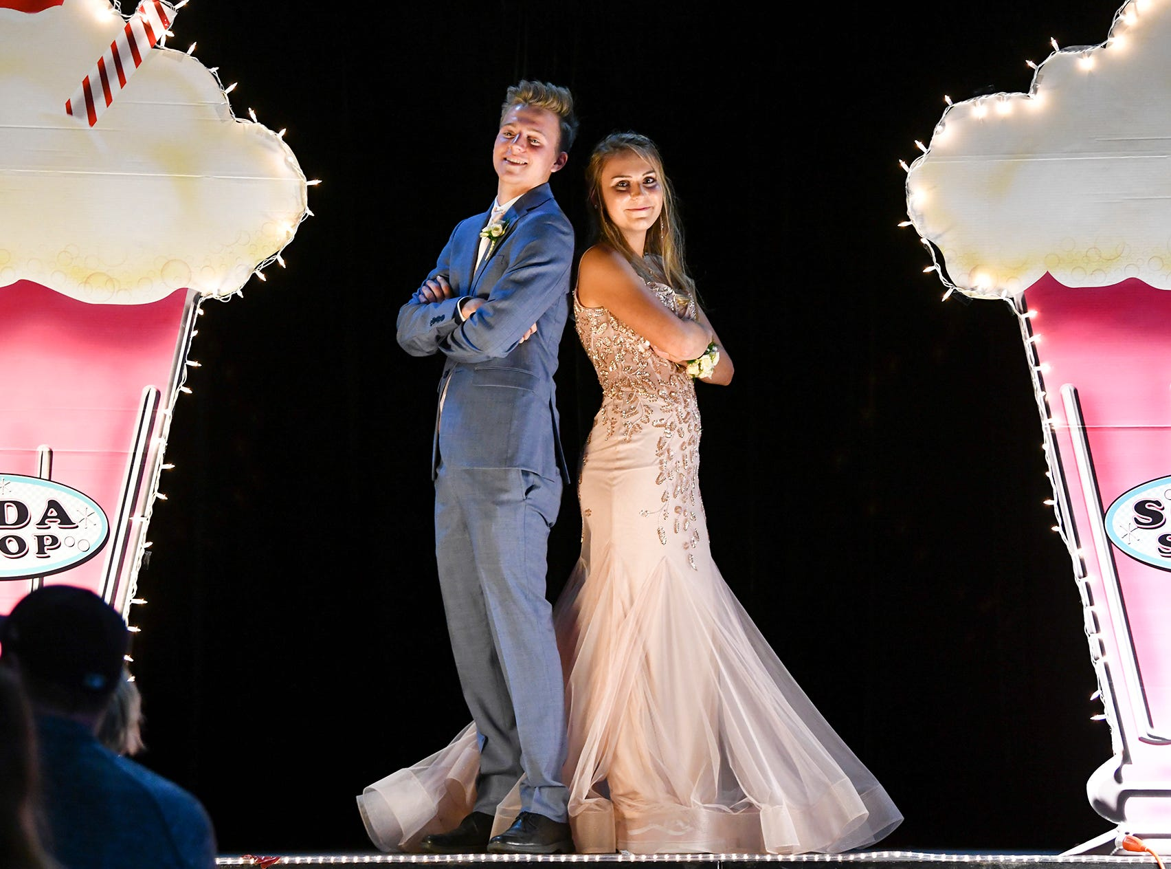 A couple strikes a pose on stage during Sartell High School's prom grand march Saturday, May 4, at the River's Edge Convention Center in St. Cloud.