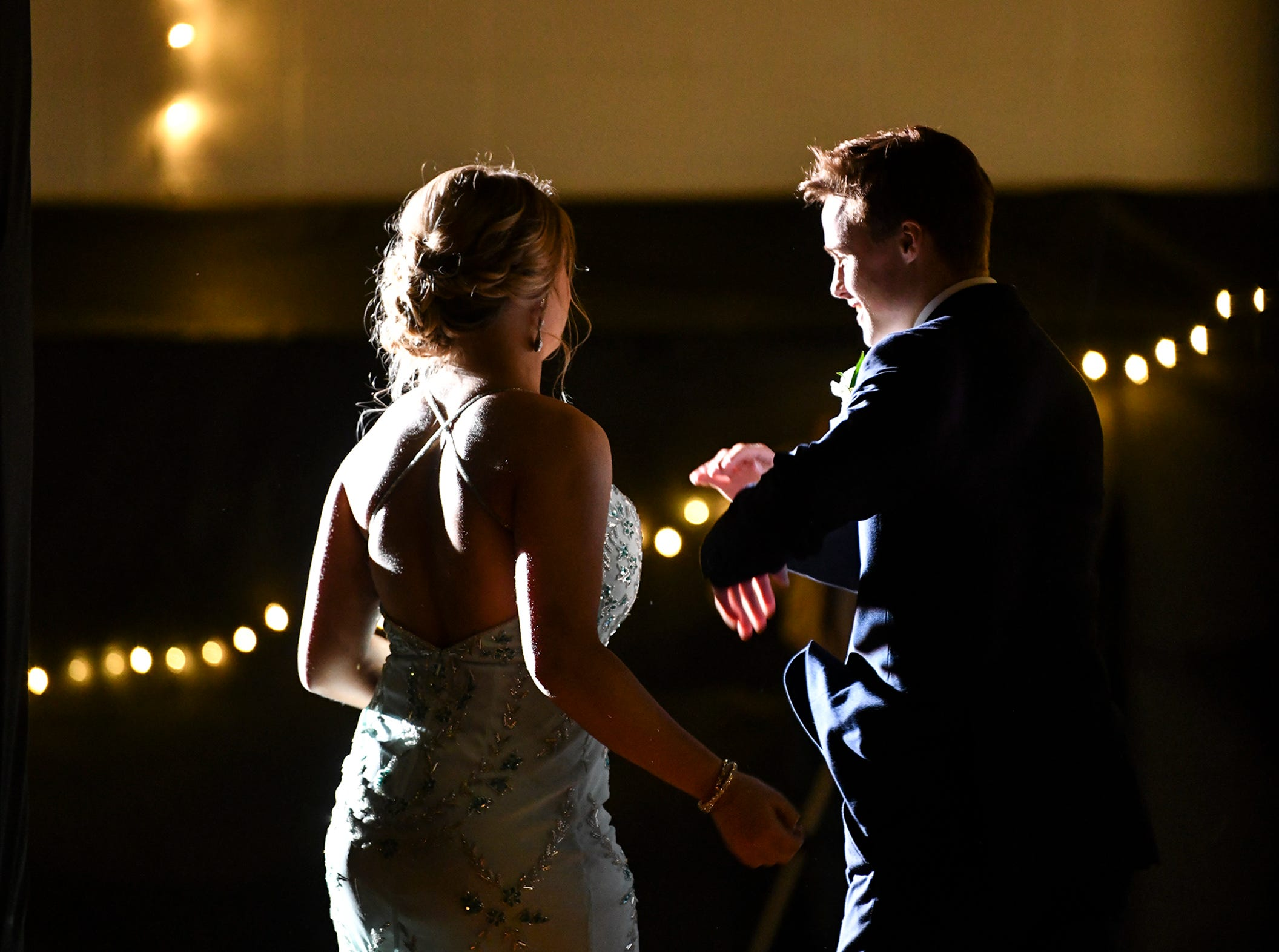 A couple take their turn at prom grand march Saturday, May 4, at Cathedral High School in St. Cloud.