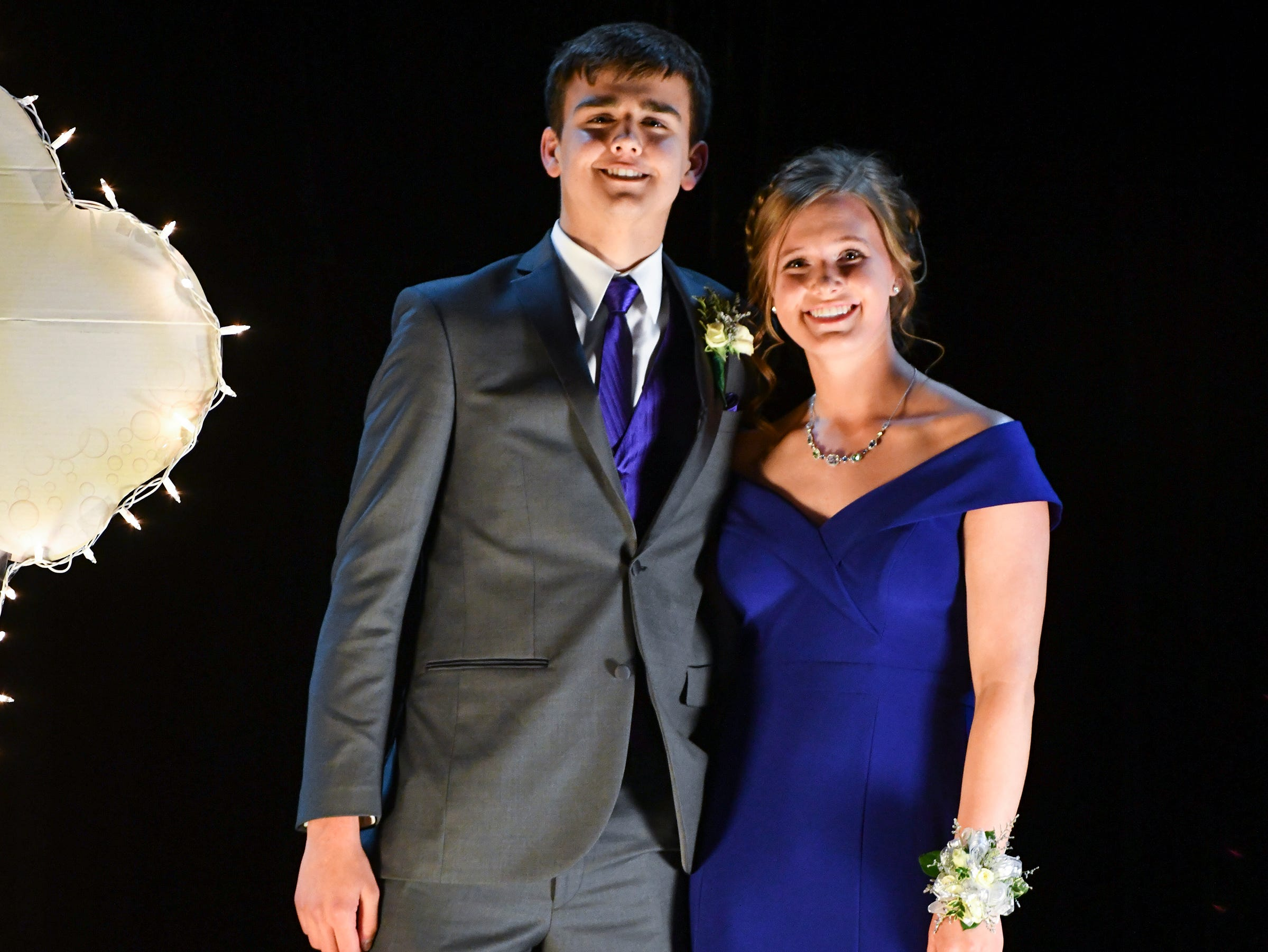 A couple smiles during Sartell High School's prom grand march Saturday, May 4, at the River's Edge Convention Center in St. Cloud.