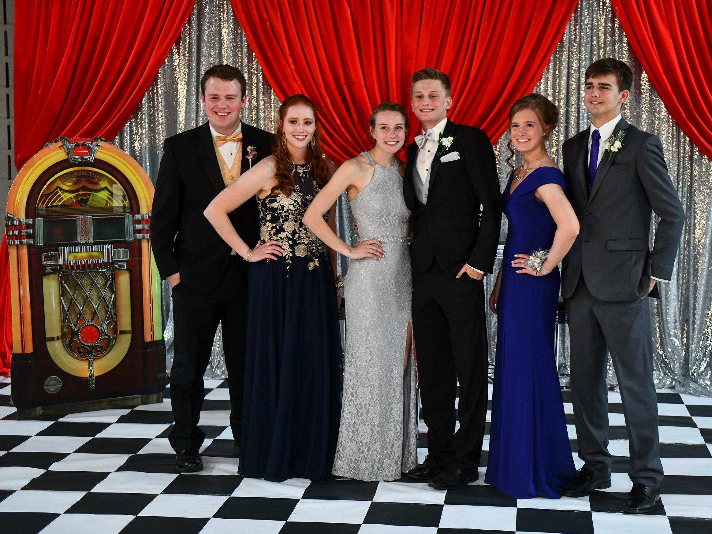 Promgoers gather for a photo during Sartell High School prom Saturday, May 4, in St. Cloud.