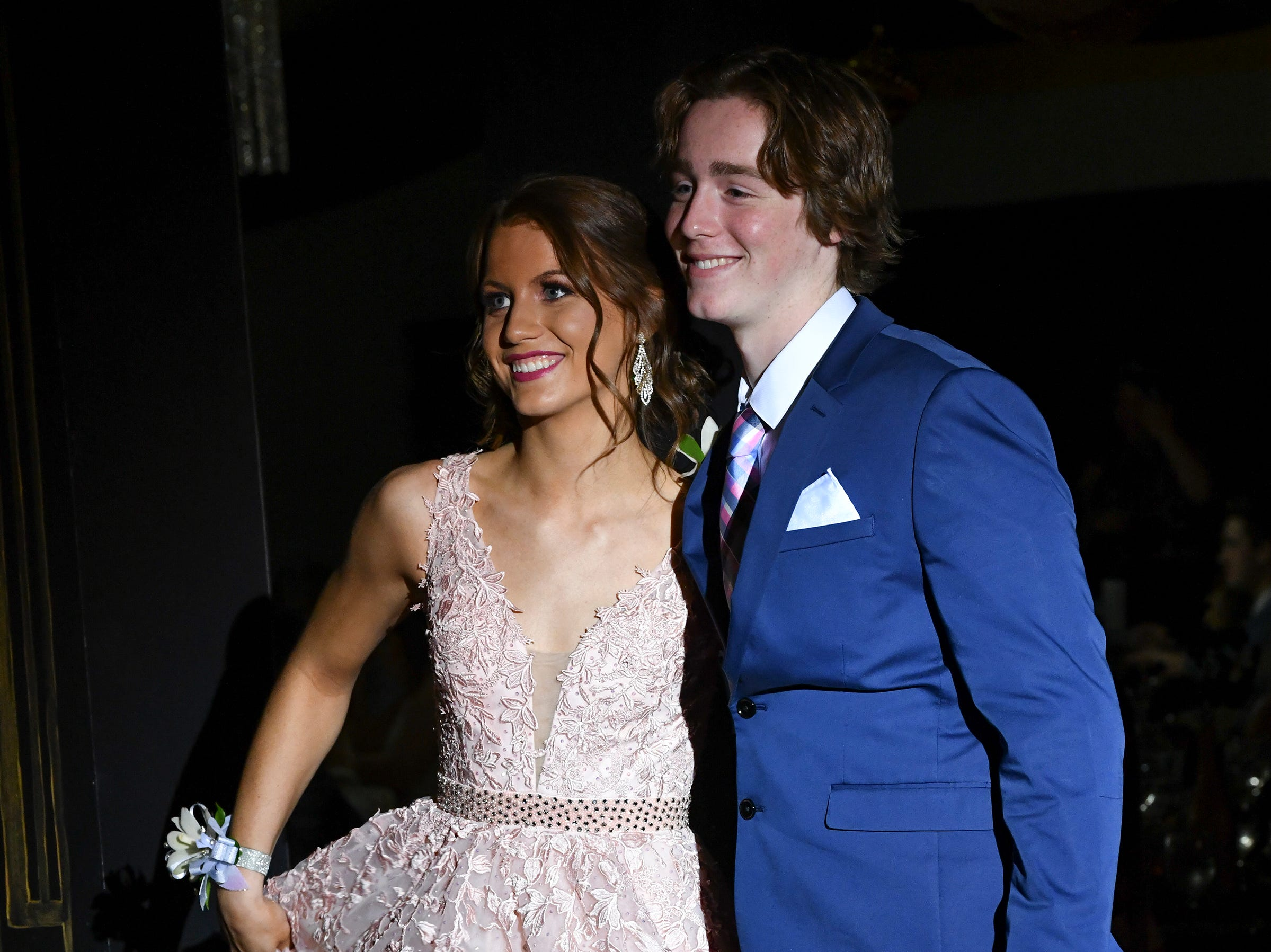 Students smile during prom grand march Saturday, May 4, at Cathedral High School in St. Cloud.