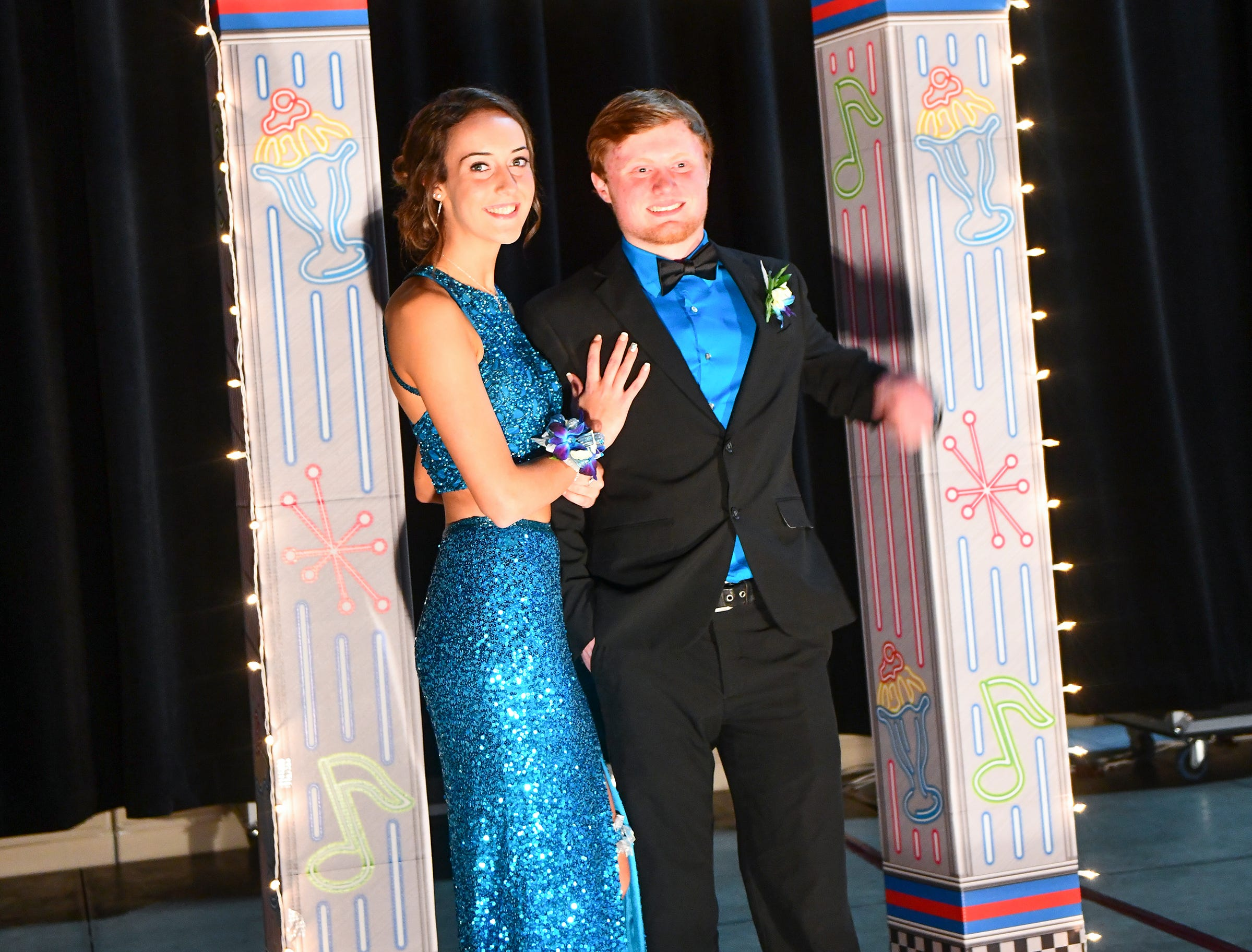 Promgoers strike a pose on stage during Sartell High School's prom grand march Saturday, May 4, at the River's Edge Convention Center in St. Cloud.