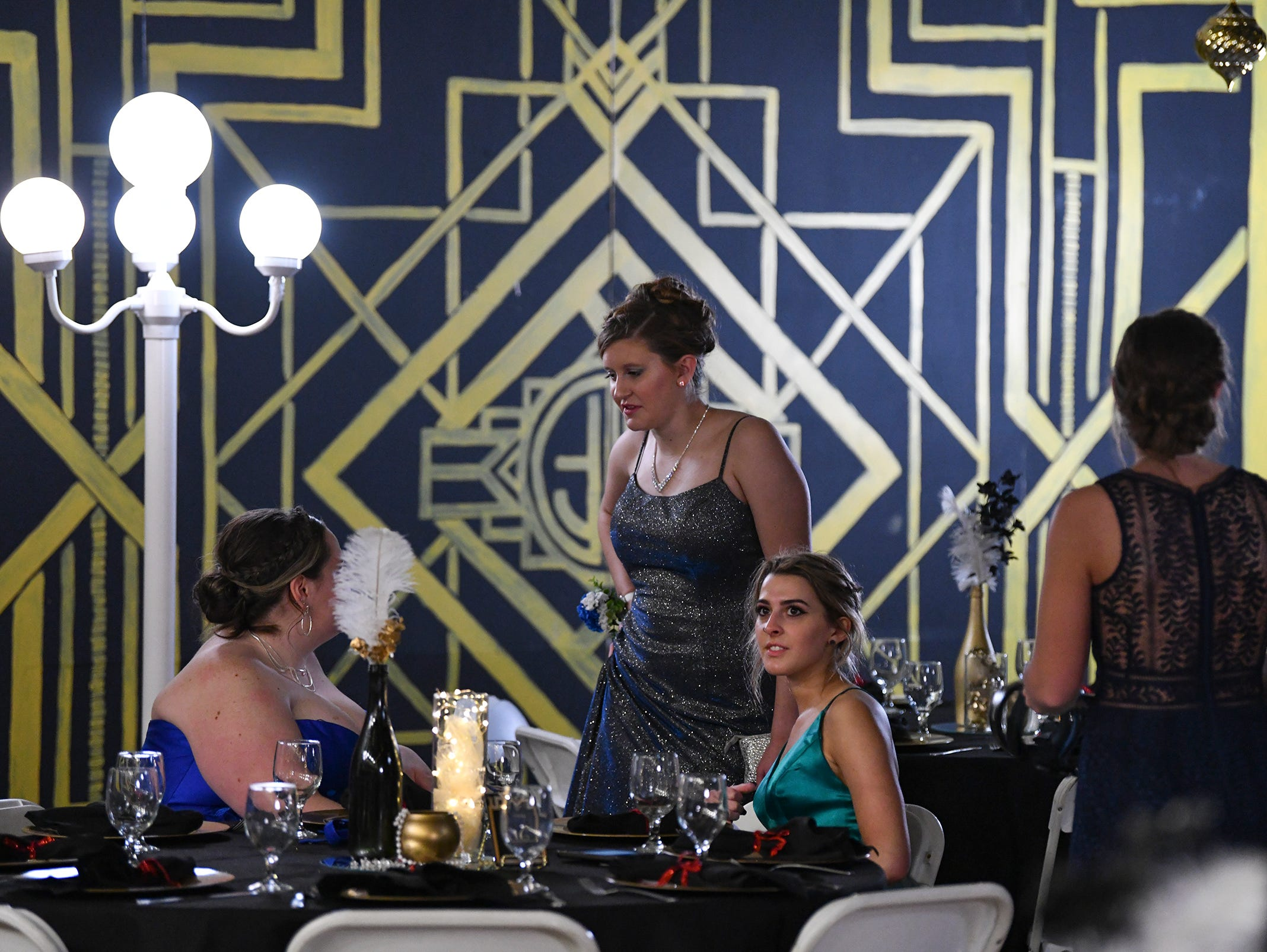 Cathedral students take their seats for their Great Gatsby-themed prom Saturday, May 4, at Cathedral High School in St. Cloud.