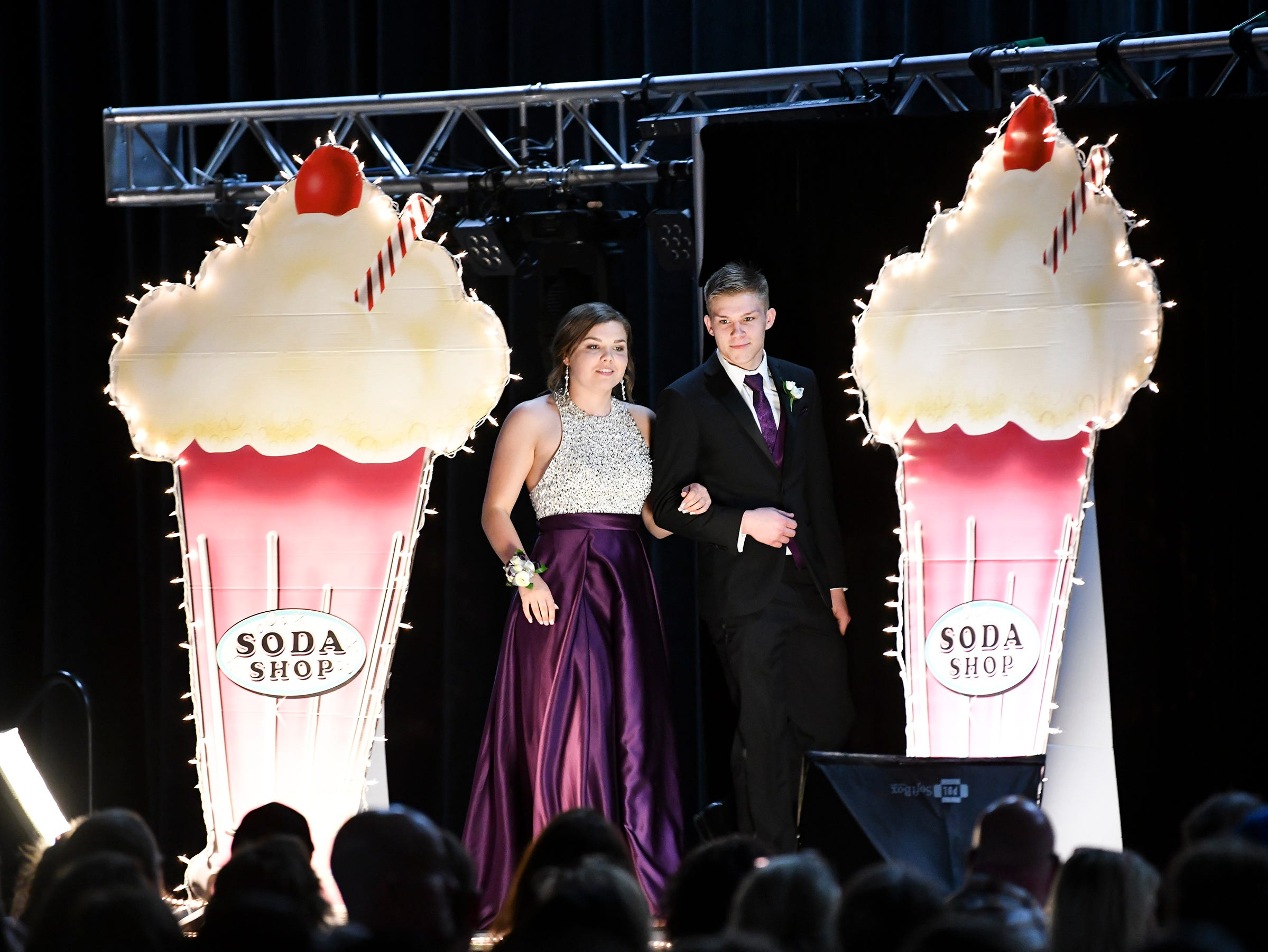 A couple takes the grand march stage during Sartell High School's prom Saturday, May 4, at the River's Edge Convention Center in St. Cloud.
