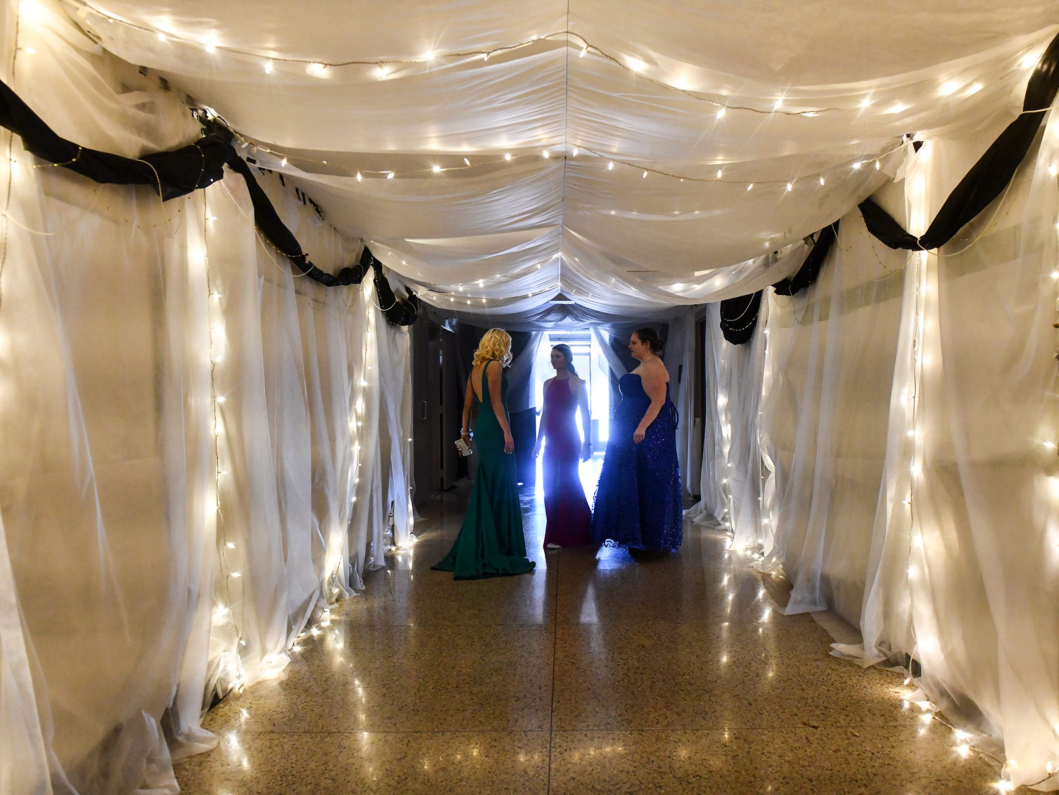 Students make their way into the gymnasium for prom Saturday, May 4, at Cathedral High School in St. Cloud.