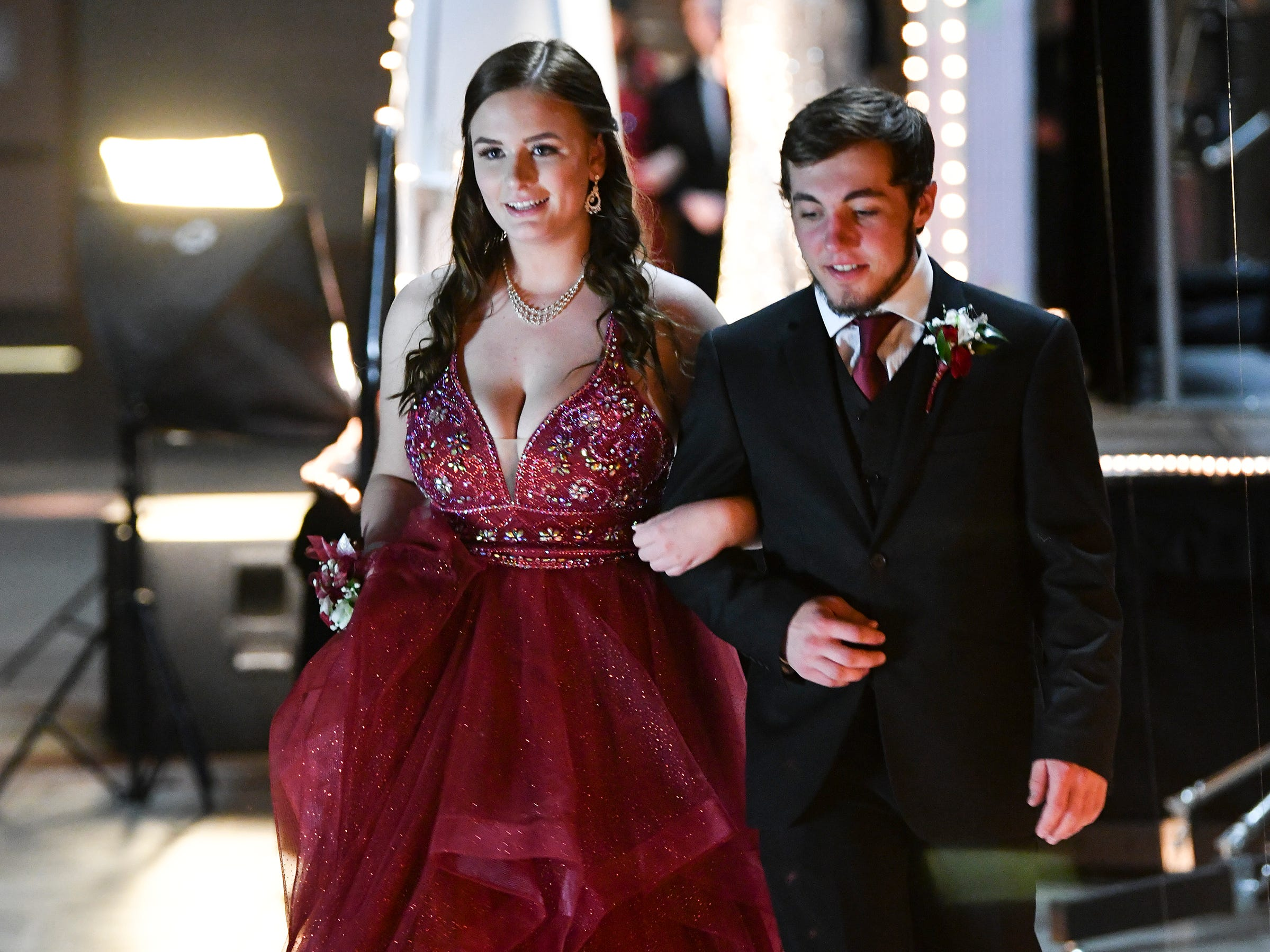 A couple makes their way down the grand march route during Sartell High School's prom Saturday, May 4, at the River's Edge Convention Center in St. Cloud.