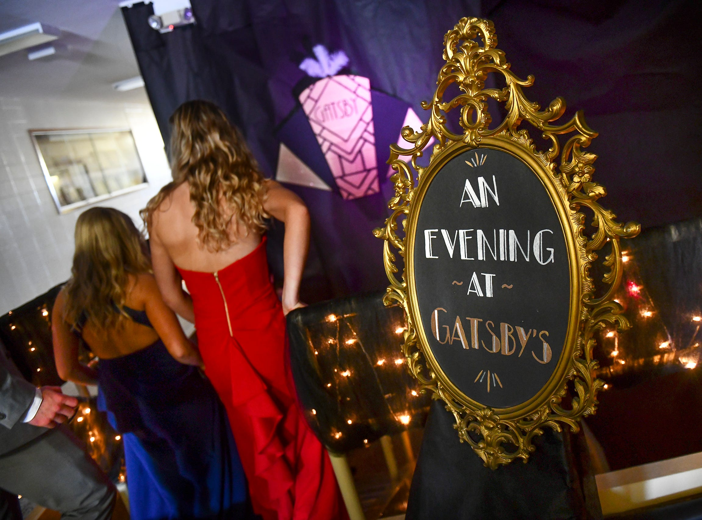 Promgoers walk past a sign on their way to prom Saturday, May 4, at Cathedral High School in St. Cloud.