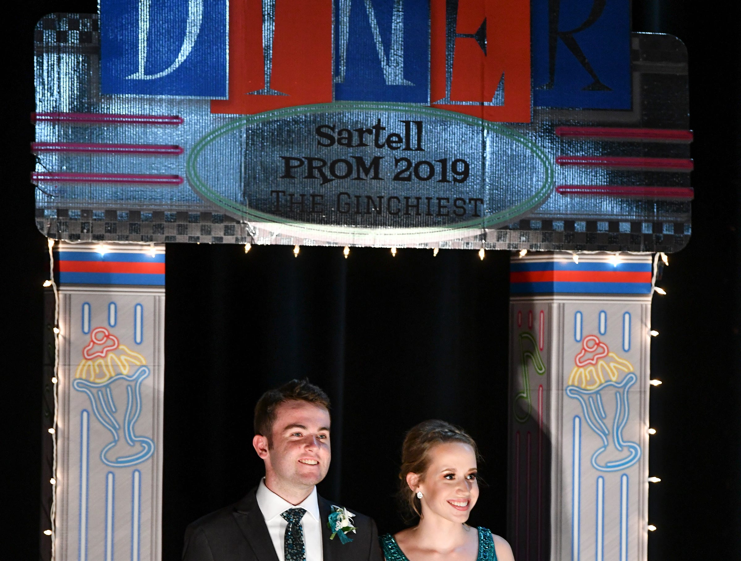 A couple takes their turn during Sartell High School's prom grand march Saturday, May 4, at the River's Edge Convention Center in St. Cloud.