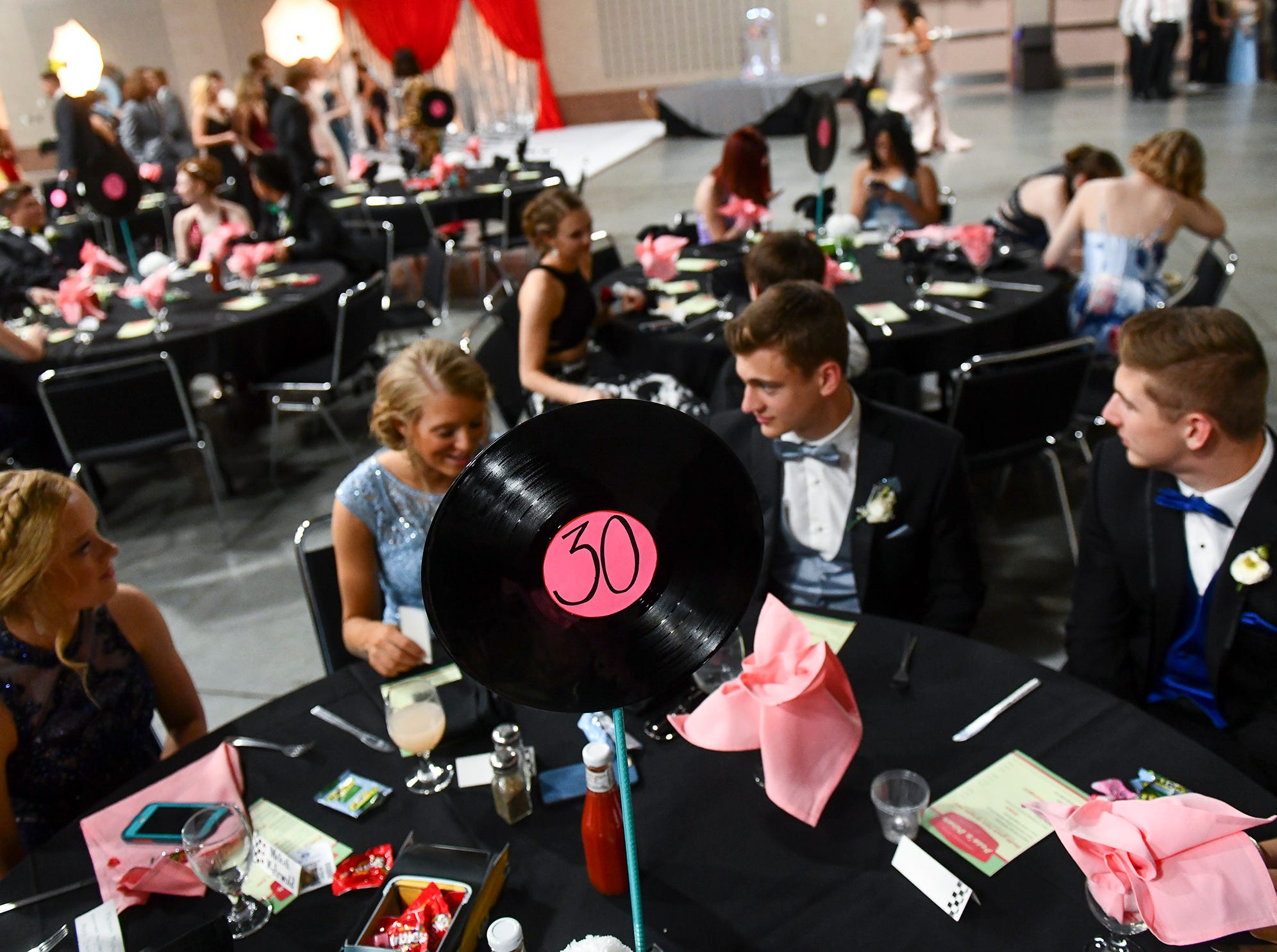 Couples take their seats for Sartell prom Saturday in St. Cloud.