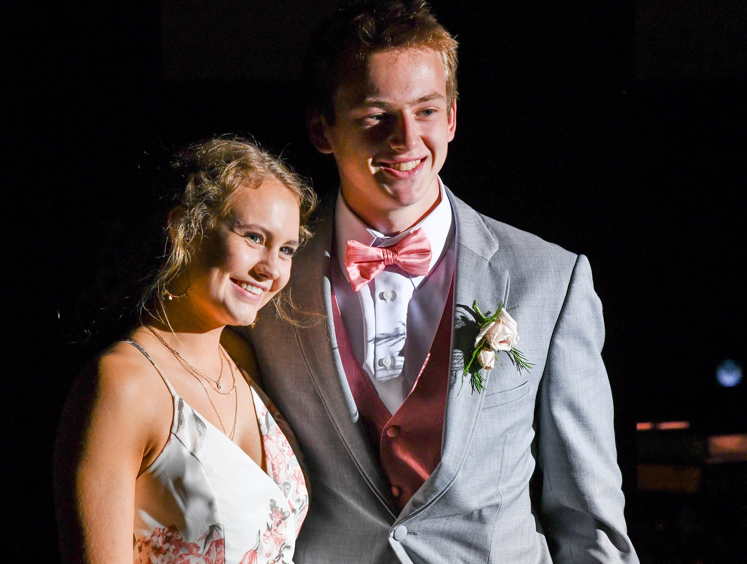 Students smile during their turn at prom grand march Saturday, May 4, at Cathedral High School in St. Cloud.