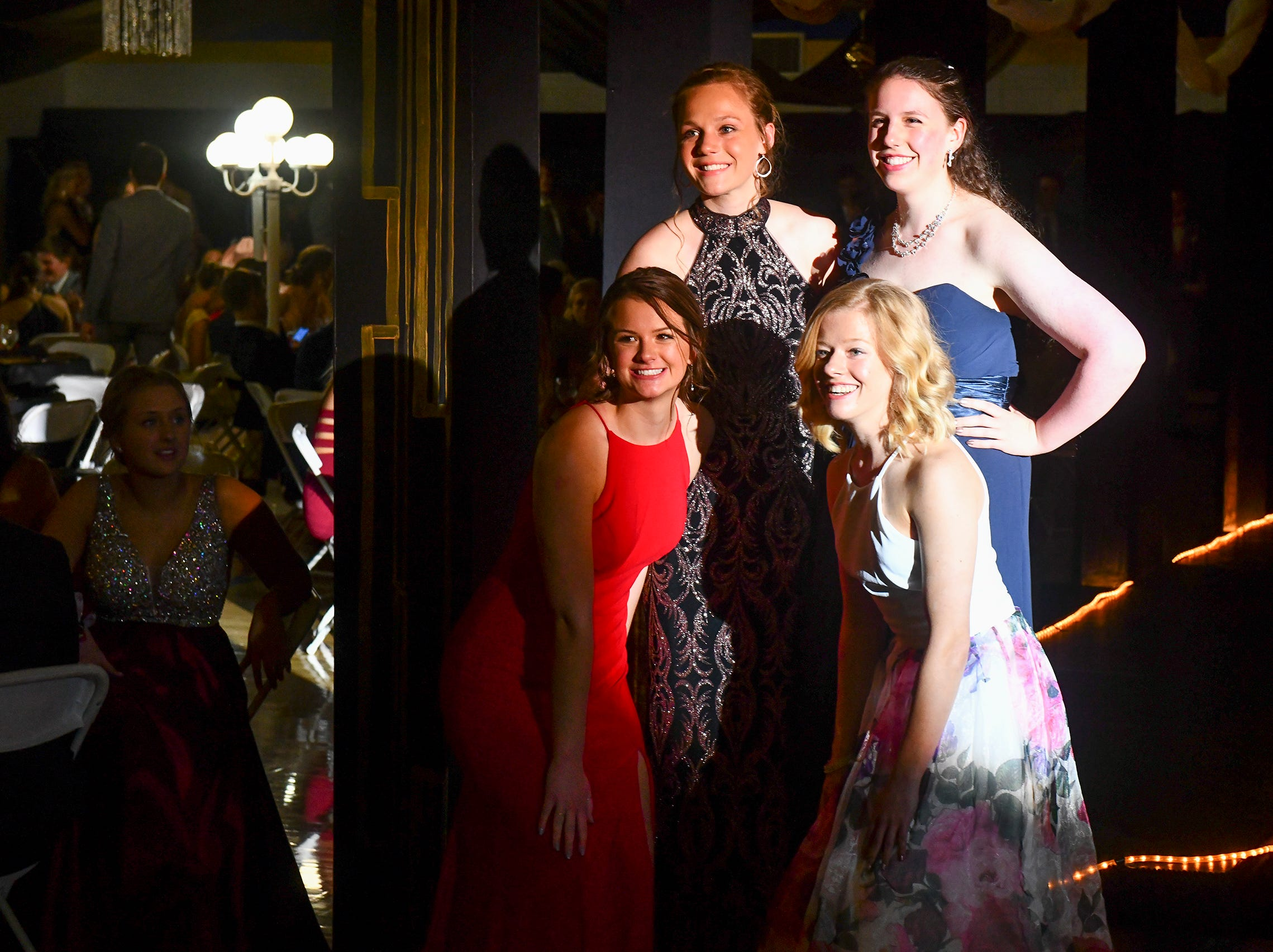 Students pose for photos during prom grand march Saturday, May 4, at Cathedral High School in St. Cloud.