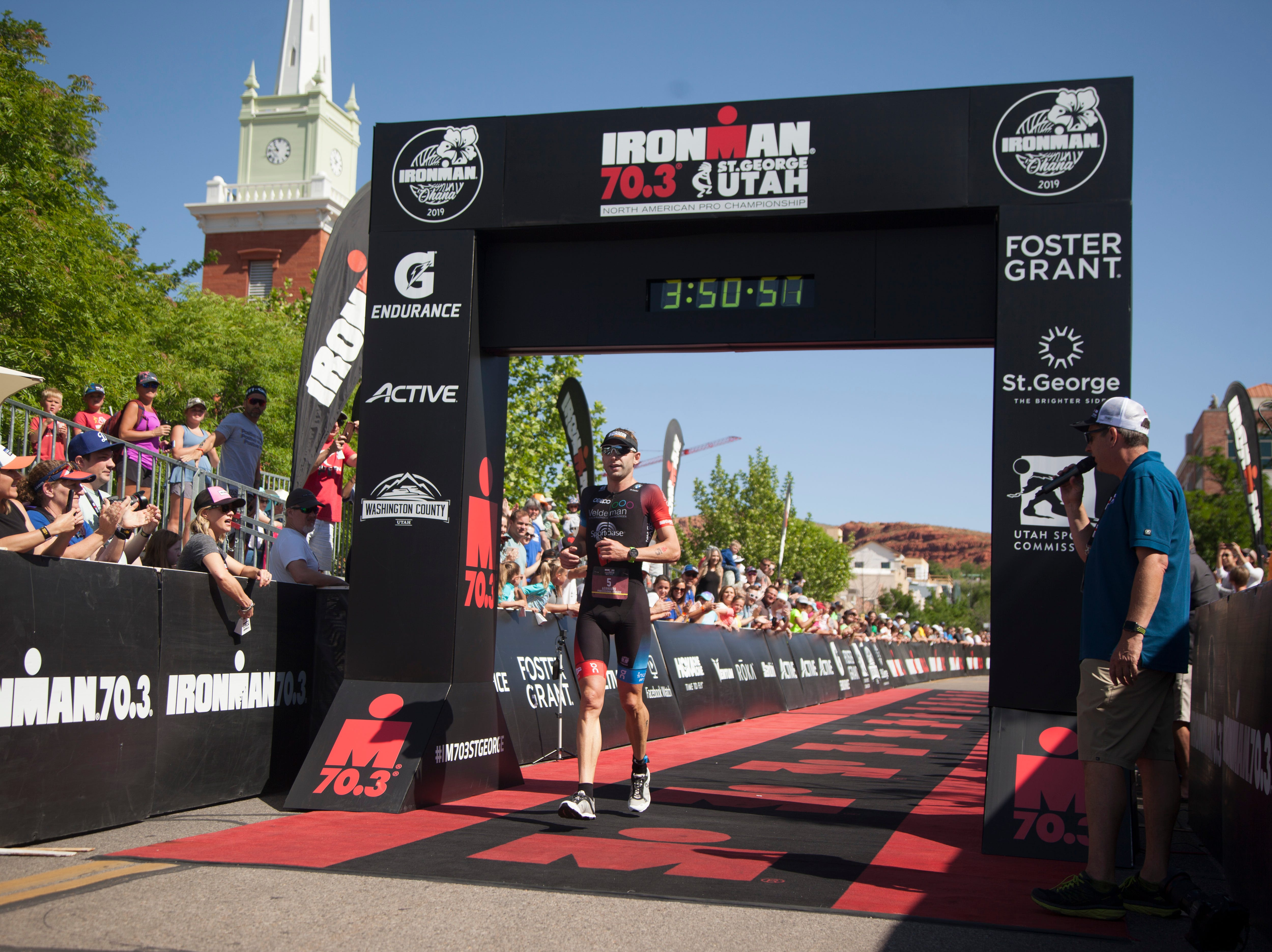 Bart Aernouts crosses the finish line of the St. George Ironman Saturday, May 4, 2019.