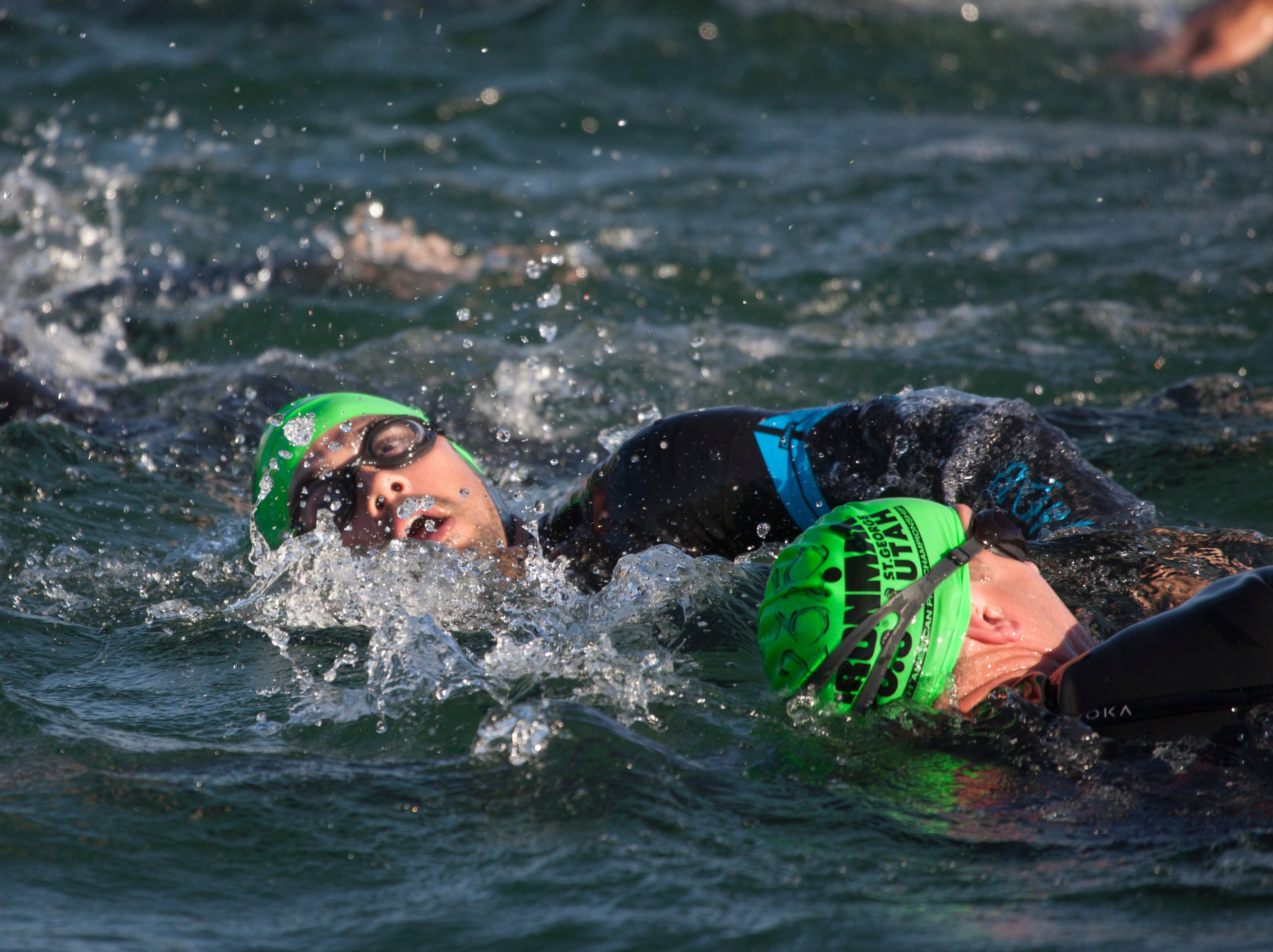 St. George Ironman contestants finish the swim portion of the race Saturday, May 4, 2019.
